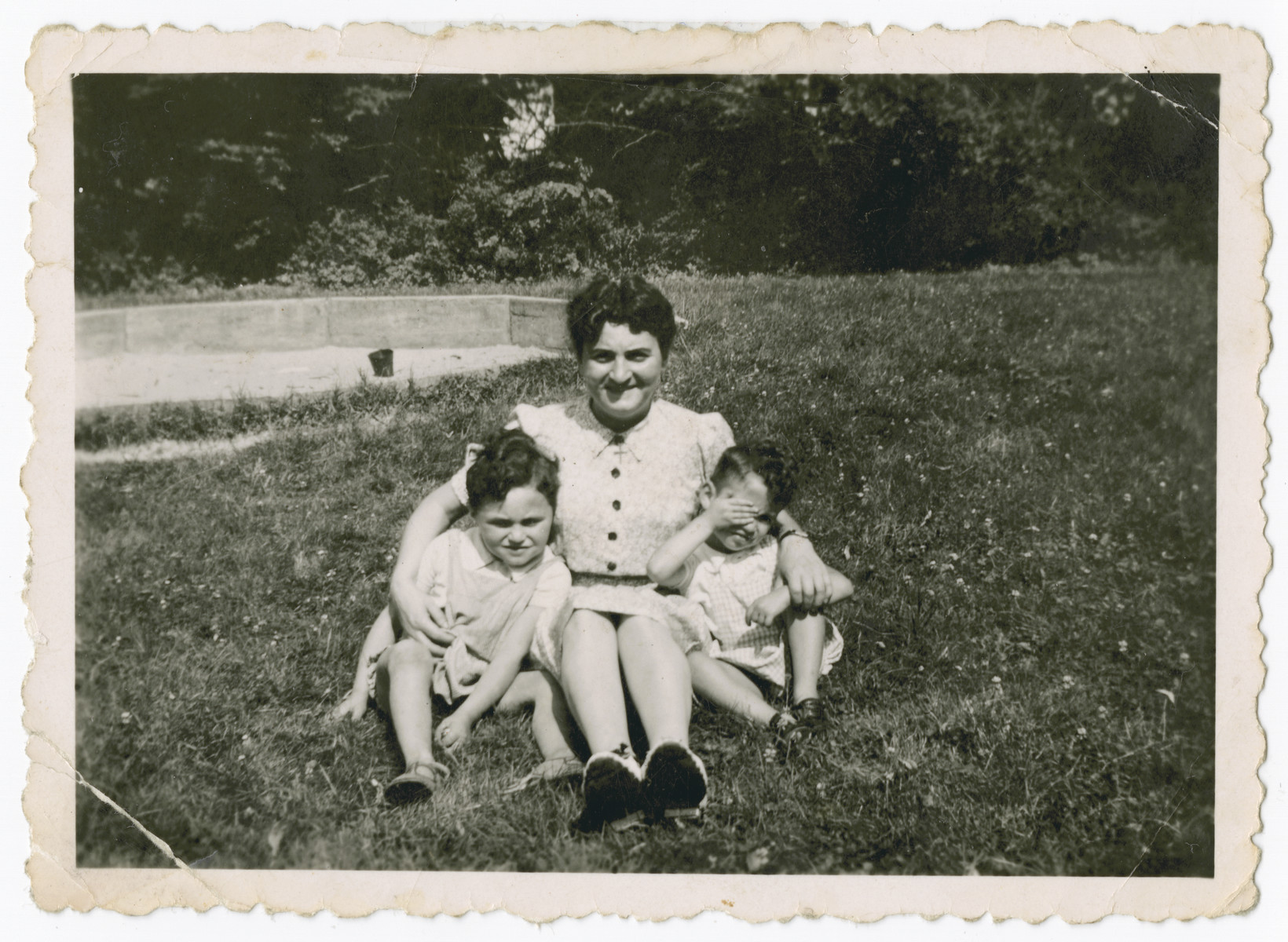 Frymetta Hochglaube poses outside with her two children at the Red Castle in Linden, outside of Brussels, during a rare visit.