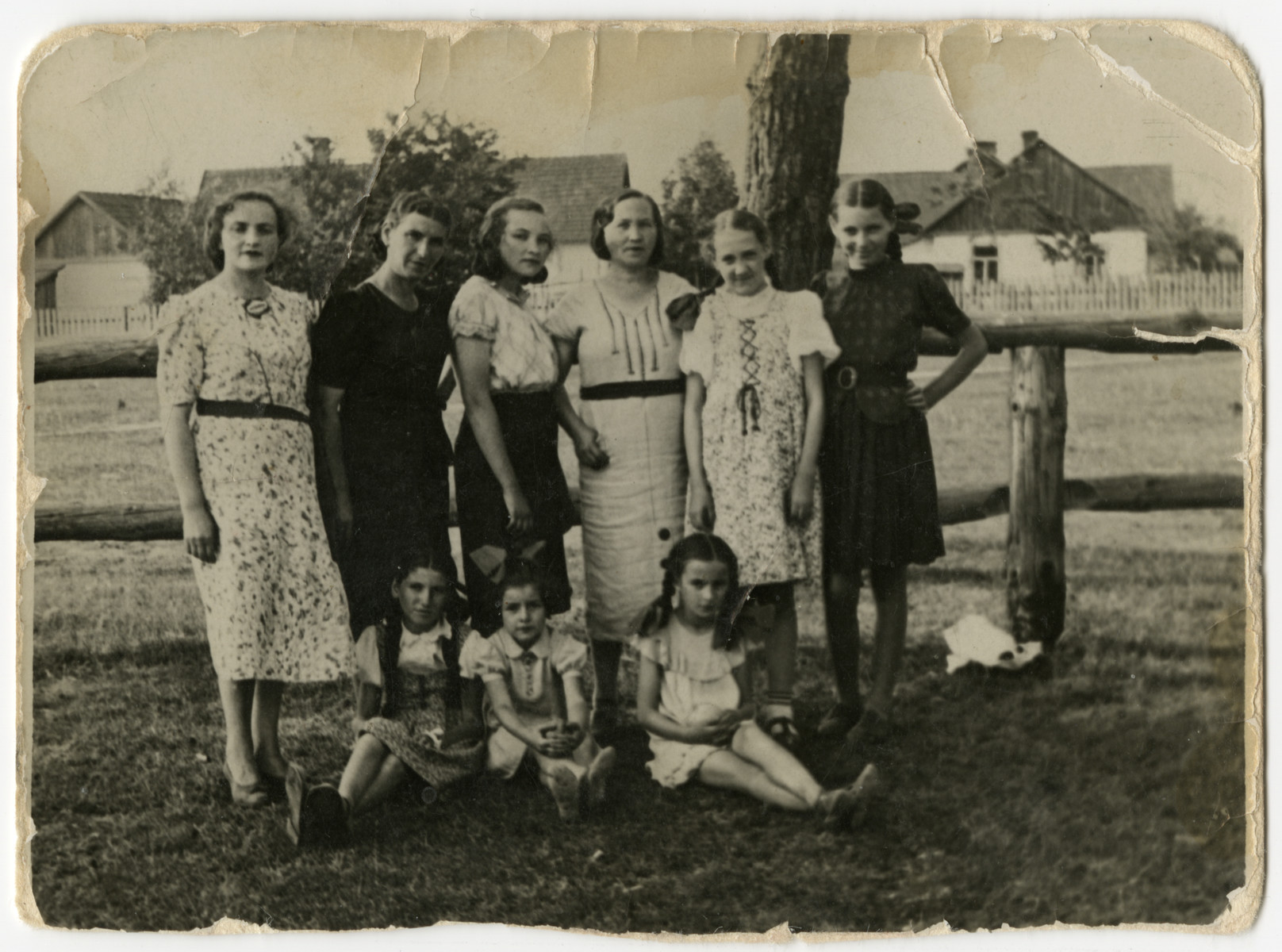 Group portrait of woman and children standing outside in Warsaw before the war.  Among those pictured is  Sura Kupersztajn, Clara's  sister-in-law, who perished during the Holocaust.