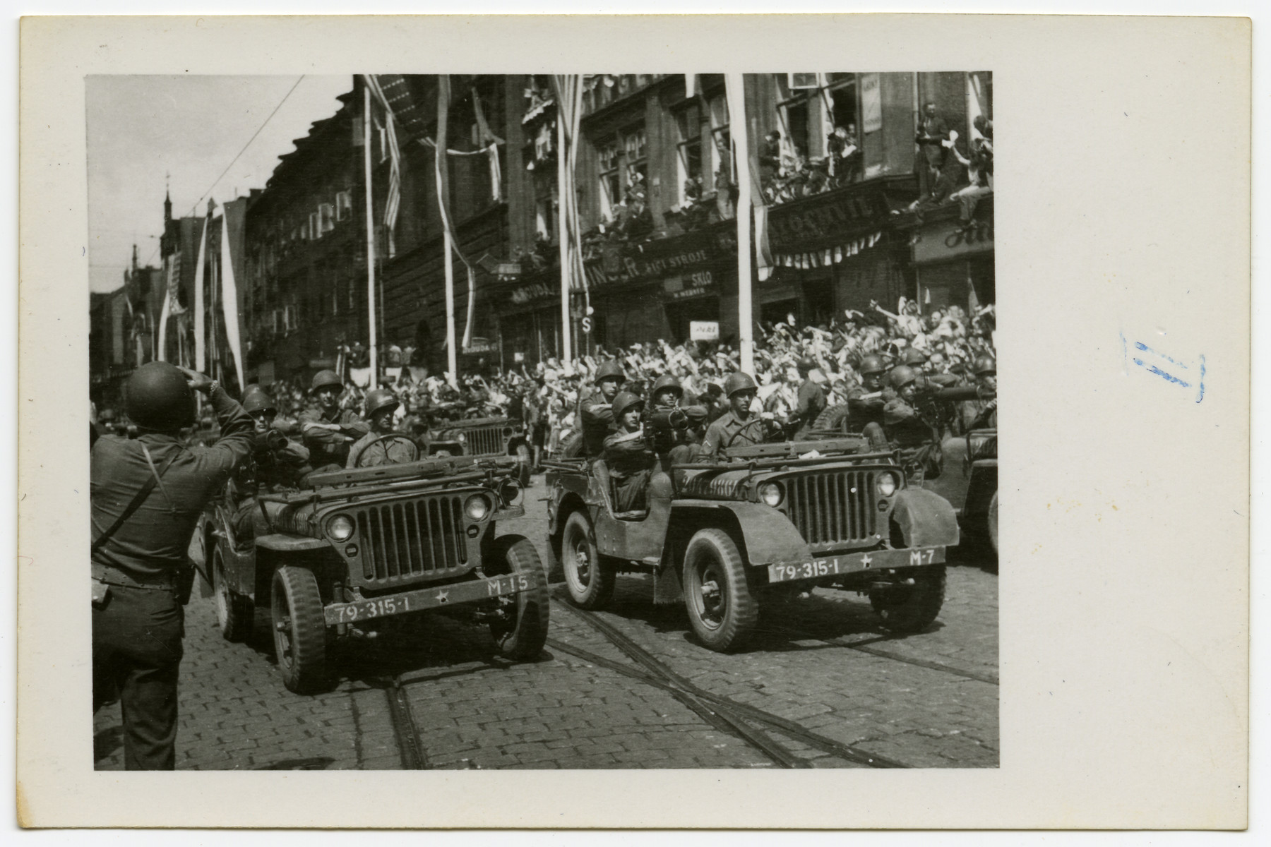 American soldiers drive through Pilsen, Czechoslovakia on its liberation day.