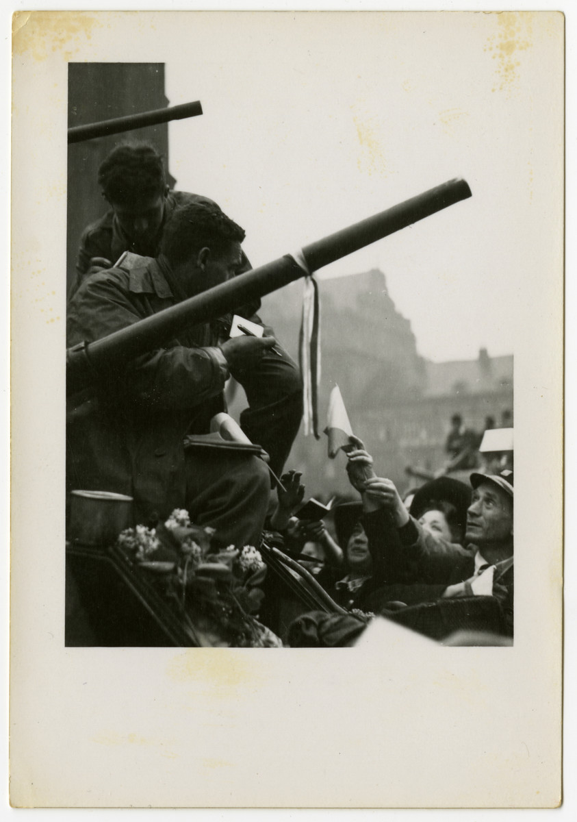 Newly liberated Czech citizens welcome American soldiers in Pilsen.