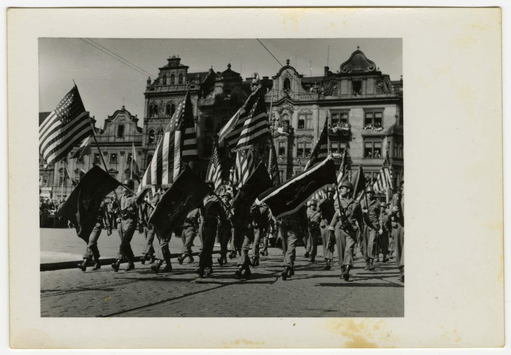 American soldiers march through Pilsen, Czechoslovakia on its liberation day.