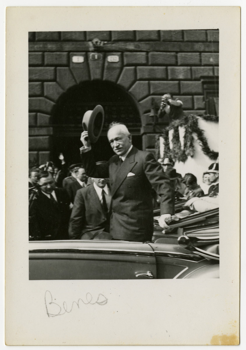 President Edvard Benes of Czechoslovakia doffs his hat as he drives through a street in Pilsen.
