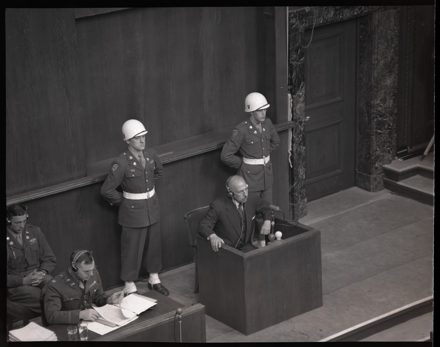 A defendant or witness gives testimony during the International Military Tribunal in Nuremberg.