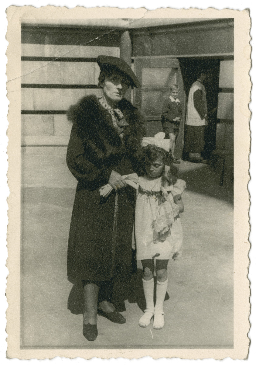 Leokadia Navrodska (left) stands with Janina Nebel (right) the day of Nebel's First Communion.