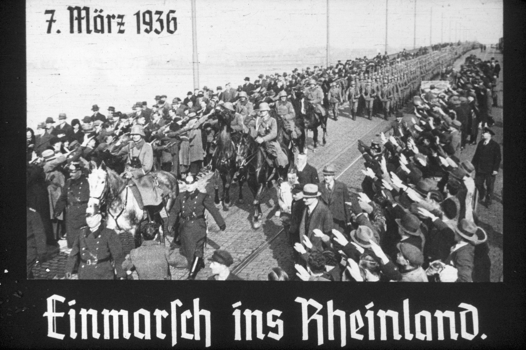 5th slide from a Hitler Youth slideshow about the aftermath of WWI, Versailles, how it was overcome and the rise of Nazism.  7. Marz 1936 Einmarsch ins Rheinland. // 7th March 1936 invasion of the Rhineland.