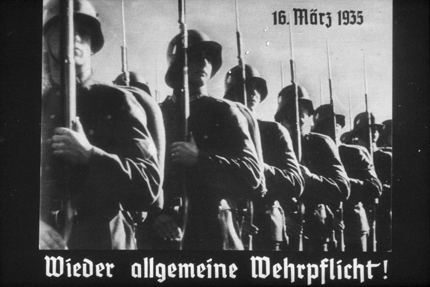 6th slide from a Hitler Youth slideshow about the aftermath of WWI, Versailles, how it was overcome and the rise of Nazism.  16 Marz 1936 Wieder allgemeine Wehrpflicht! // 16 March 1935 general  conscription again!