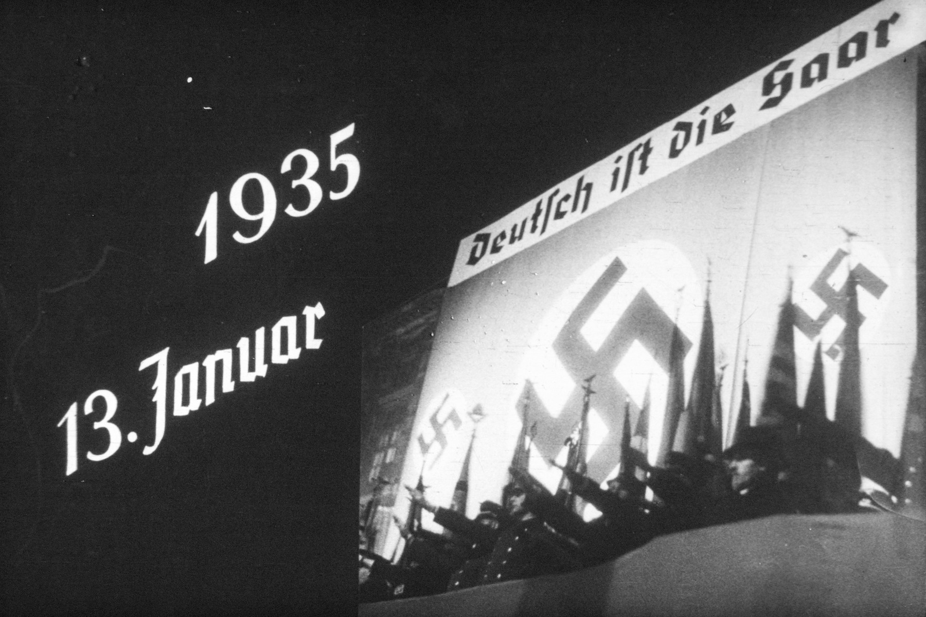 7th slide from a Hitler Youth slideshow about the aftermath of WWI, Versailles, how it was overcome and the rise of Nazism.  1935 13 Januar Deutsch ist die Saar // 1935 January 13, Saar is German