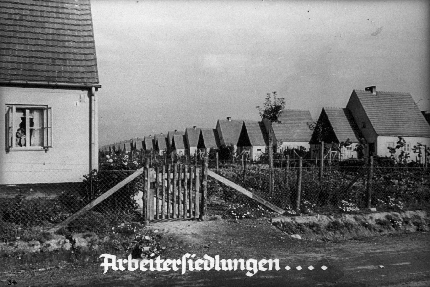 "35th Nazi propaganda slide from Hitler Youth educational material titled ""Border Land Upper Silesia.""  Arbeitersiedlungen... // workers' housing estates ..."