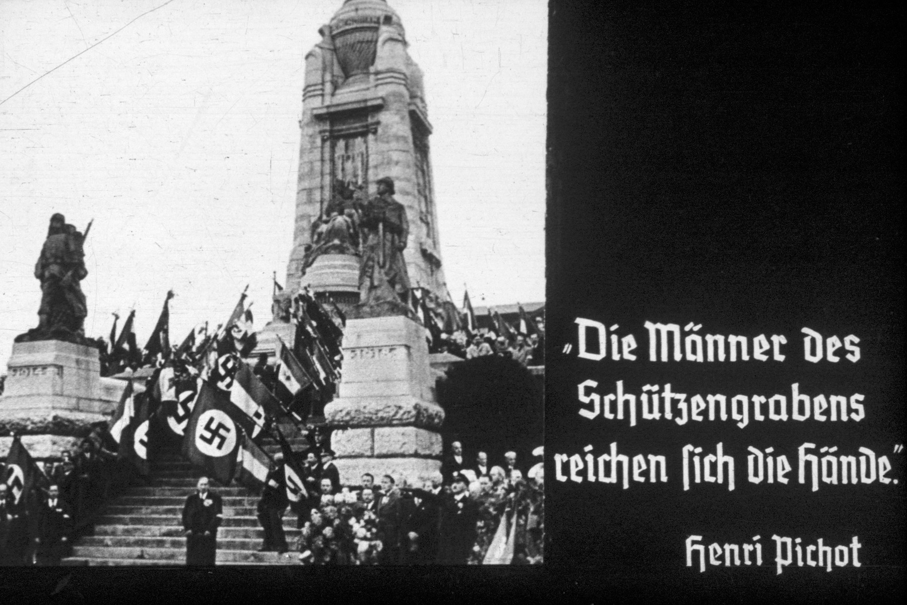 2nd slide from a Hitler Youth slideshow about the aftermath of WWI, Versailles, how it was overcome and the rise of Nazism.