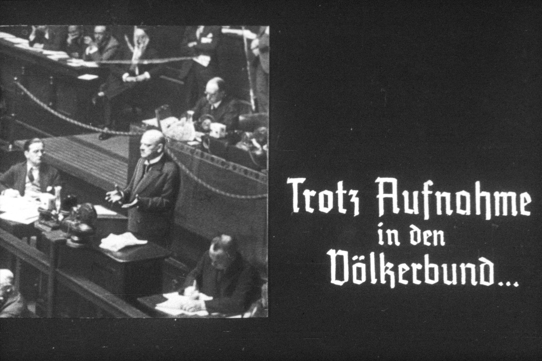 19th slide from a Hitler Youth slideshow about the aftermath of WWI, Versailles, how it was overcome and the rise of Nazism.  Trotz Aufnahme in den Völkerbund...  Despite inclusion in the League of Nations...