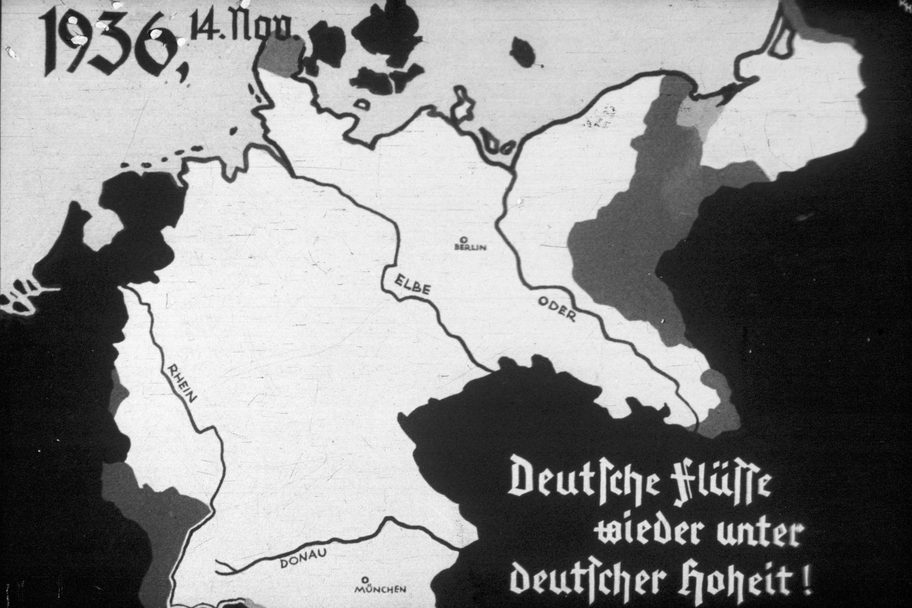 4th slide from a Hitler Youth slideshow about the aftermath of WWI, Versailles and how it was overcome and the rise of Nazism.  The slide shows the borders of Germany after November, 1936.