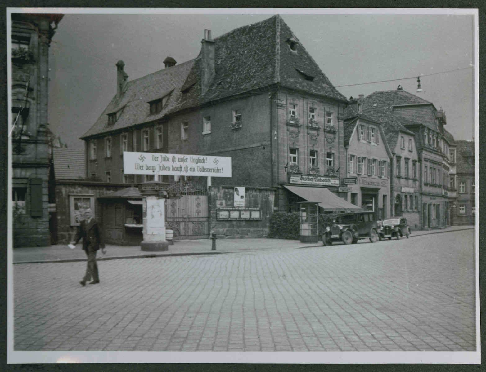 "One photograph from an album of antisemitic signs in Germany.  The sign (in German) reads, ""Der Jude ist unser Unglueck! Wer beim Juden kauft ist ein Volksverrater!""  [The Jews are our misfortune!  He who buys from Jews is a traitor to the nation!]"
