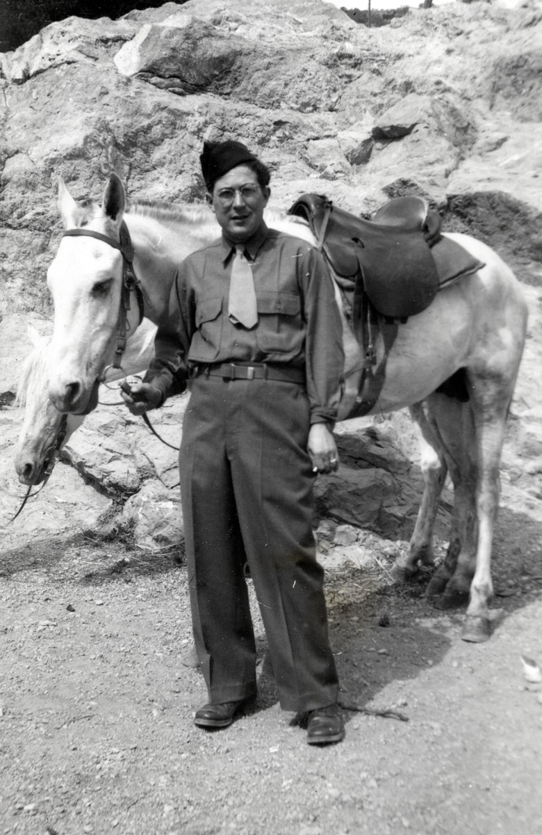 "Simon Welner stands in front of two horses wearing his US Army uniform in Northern Africa.   This image was sent to his family with the words ""From your loving father"""