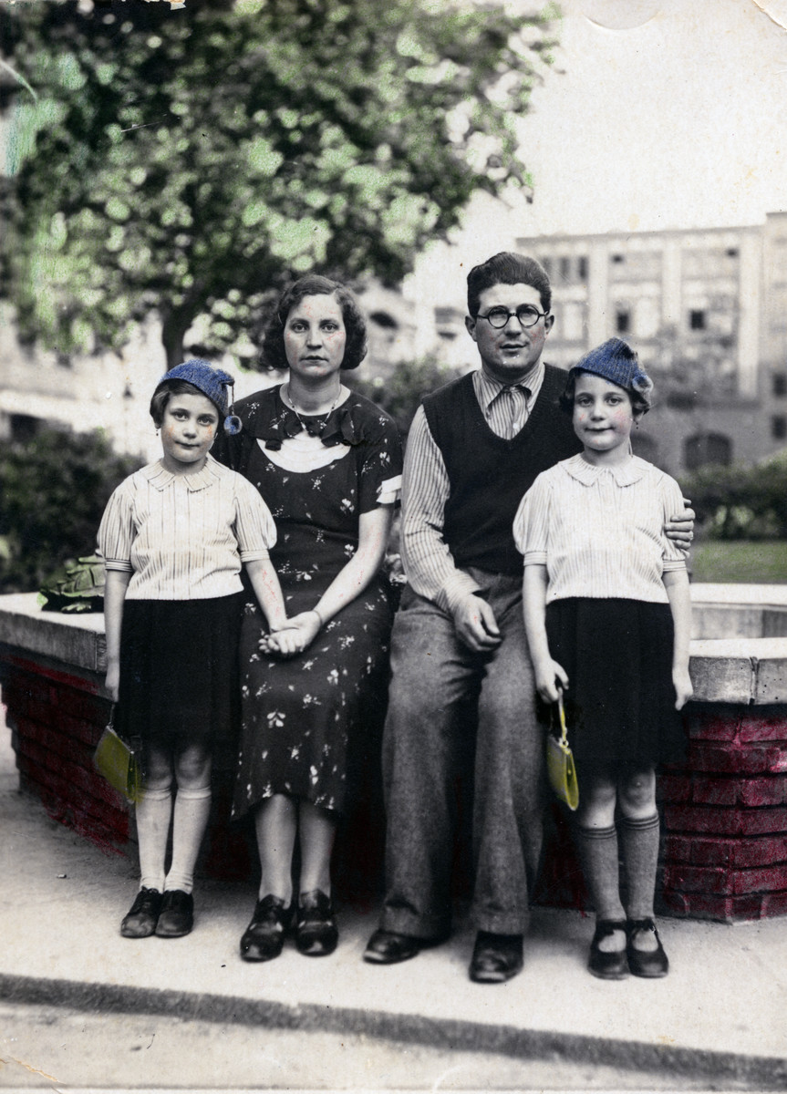 The Welner family poses outside in Berlin.  Pictured are parents Marta Anders (center, left) and Simon Welner (center, right) surrounded by their twin daughters Regina and Ruth.