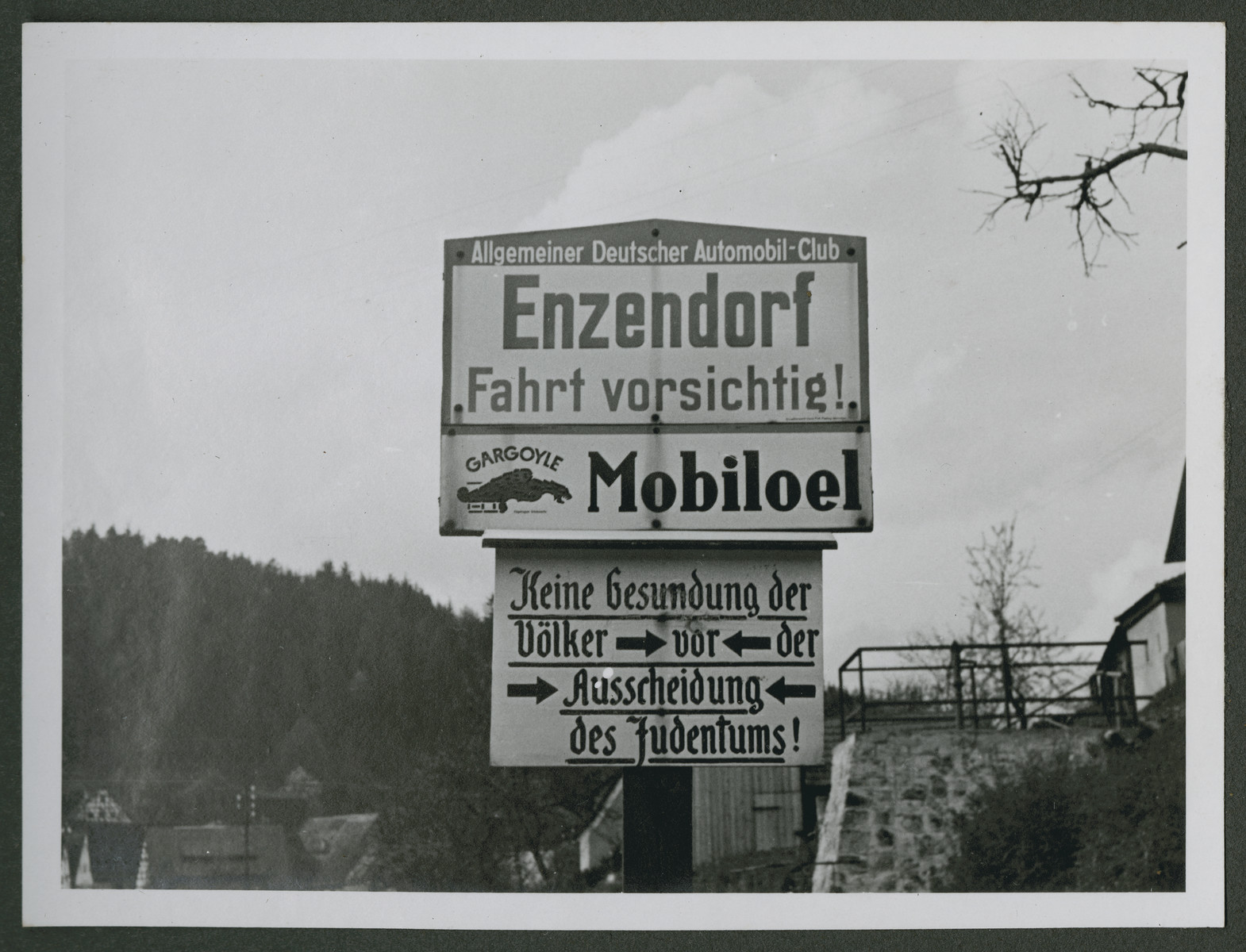 "One photograph from an album of antisemitic signs in Germany.  The sign (in German) reads, ""Keine Gesundung der Voelker vor der Ausscheidung des Judentums!"" [There will be no health for the people until the removal of the Jews.]"