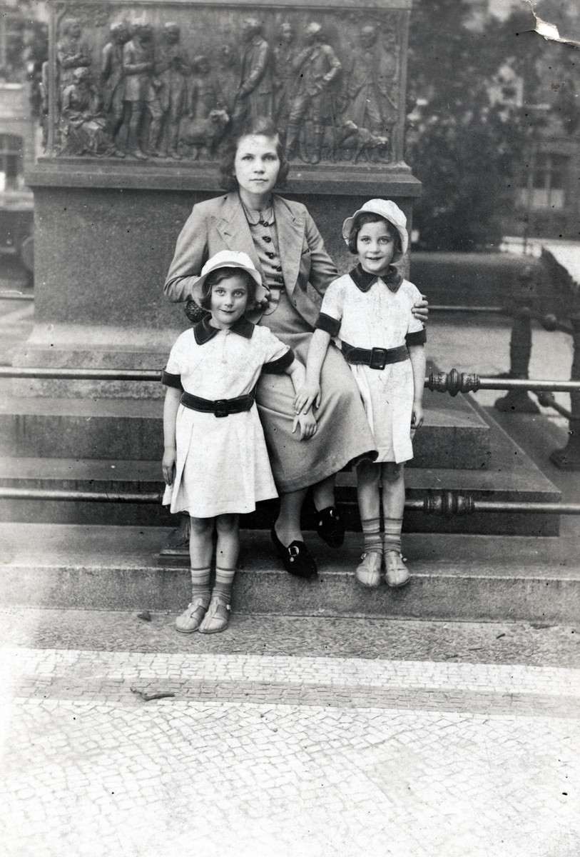 Regina and Ruth Anders stand next to a statue with their Christian aunt and future rescuer, Mathilde Anders.