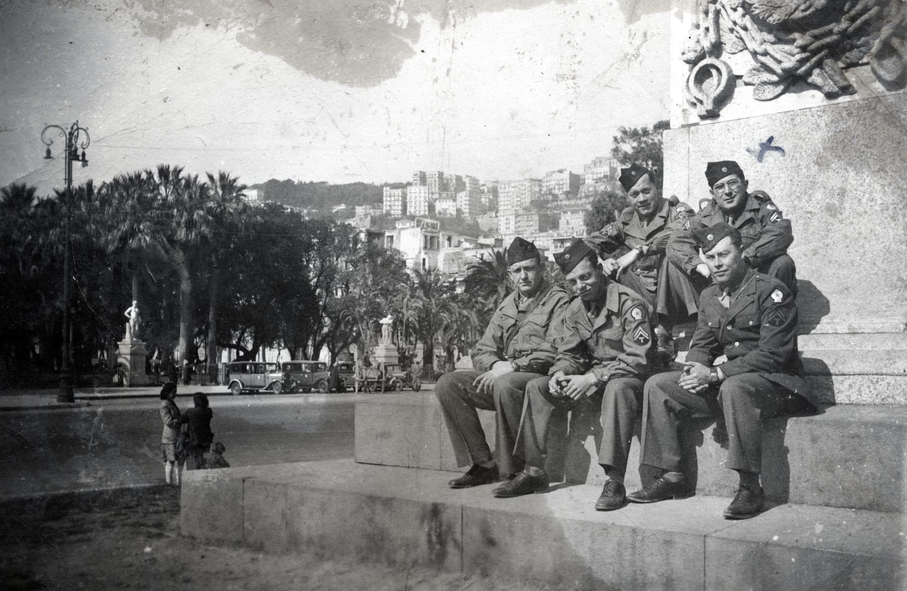 """Simon  Welner (pictured top right) poses with other American soldiers in Naples, Italy.   The photo was sent to his family with the words """"From your loving father"""""""