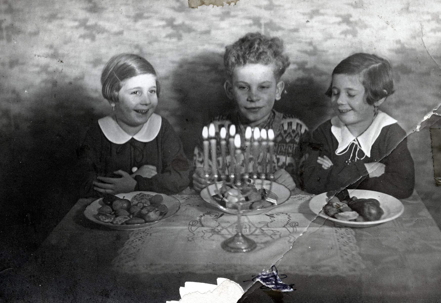 Raifeld/Welner siblings celebrate Hanukkah.   Pictured from left to right are Ruth Anders, Theo Raifeld and Regina Anders