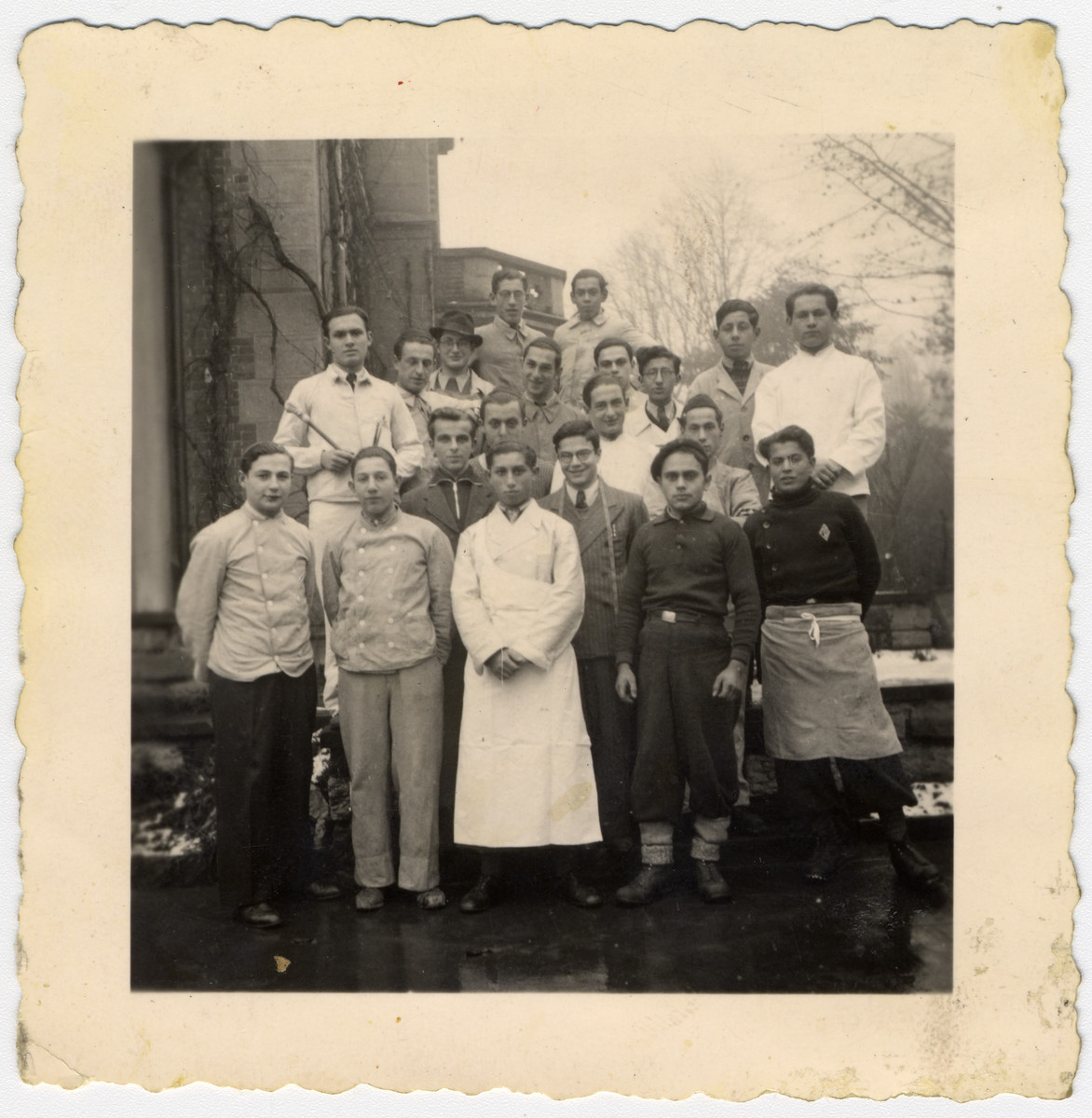 Young men at Rabbi Stern's children's home wearing the work clothes of the trades they were learning.