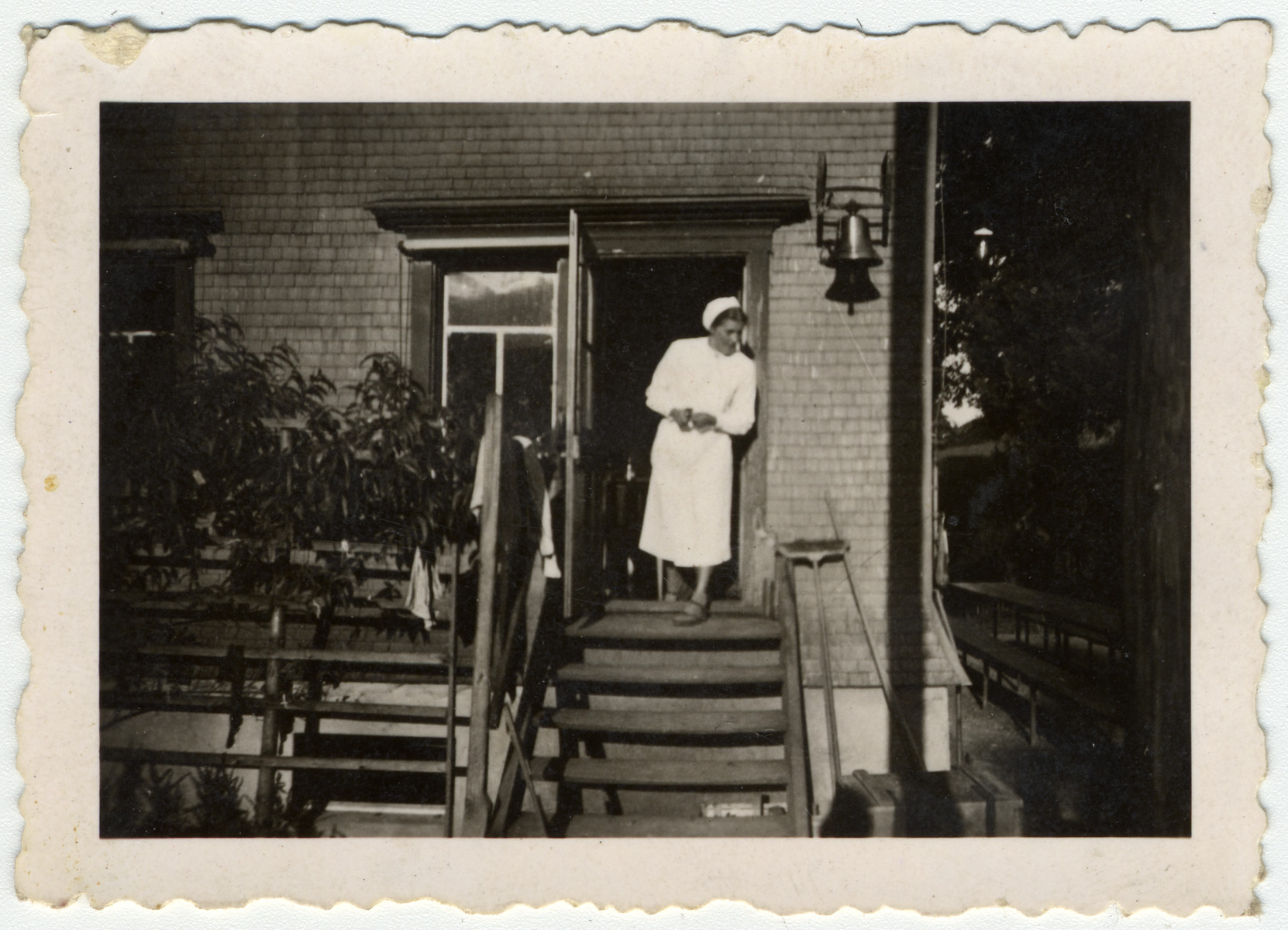 The administrator of Kinderheim Wartheim stands outside the home in Heiden.