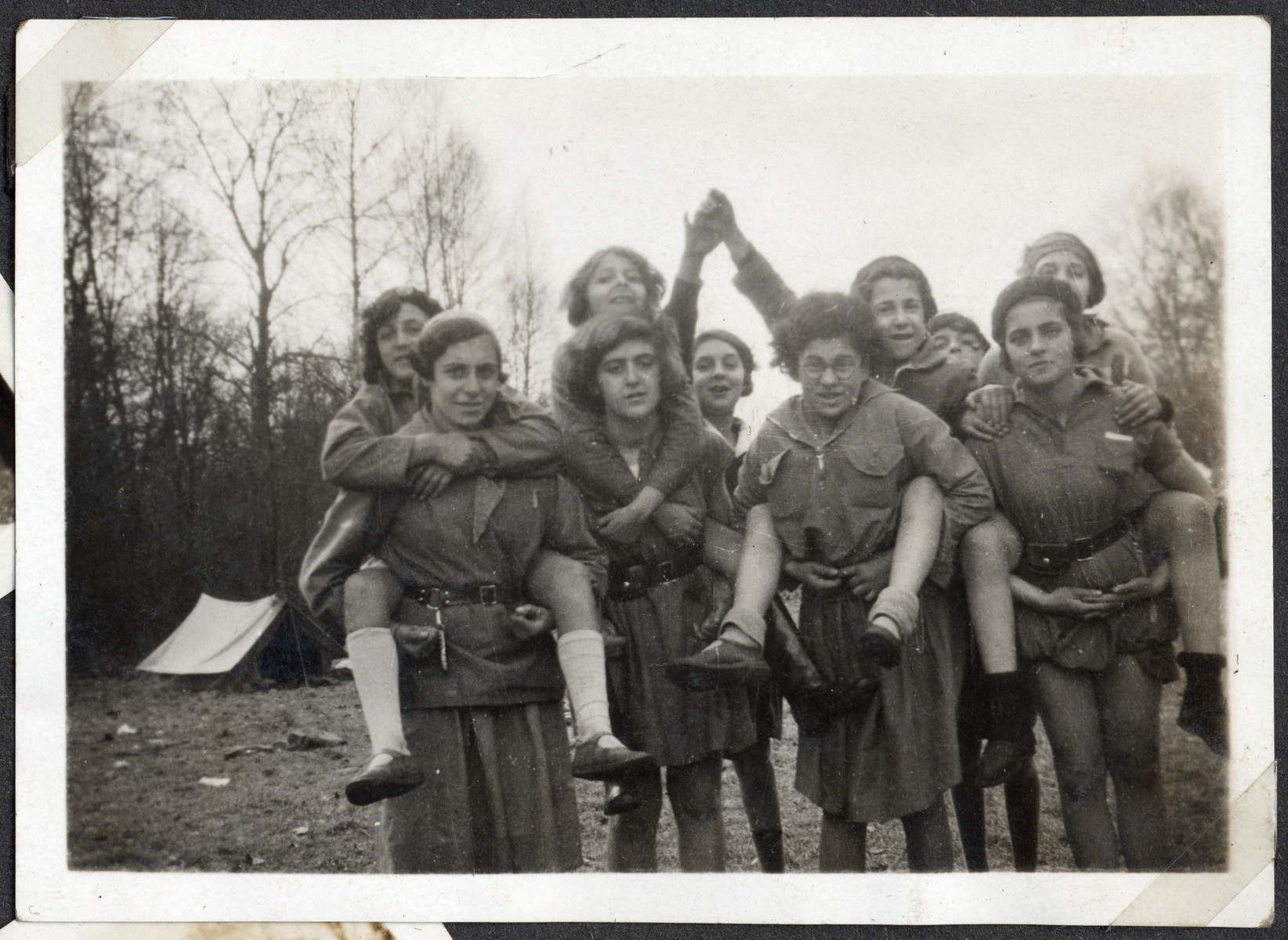 Teenage girls pose together while on camping trip with the Eclaireurs Israelites.