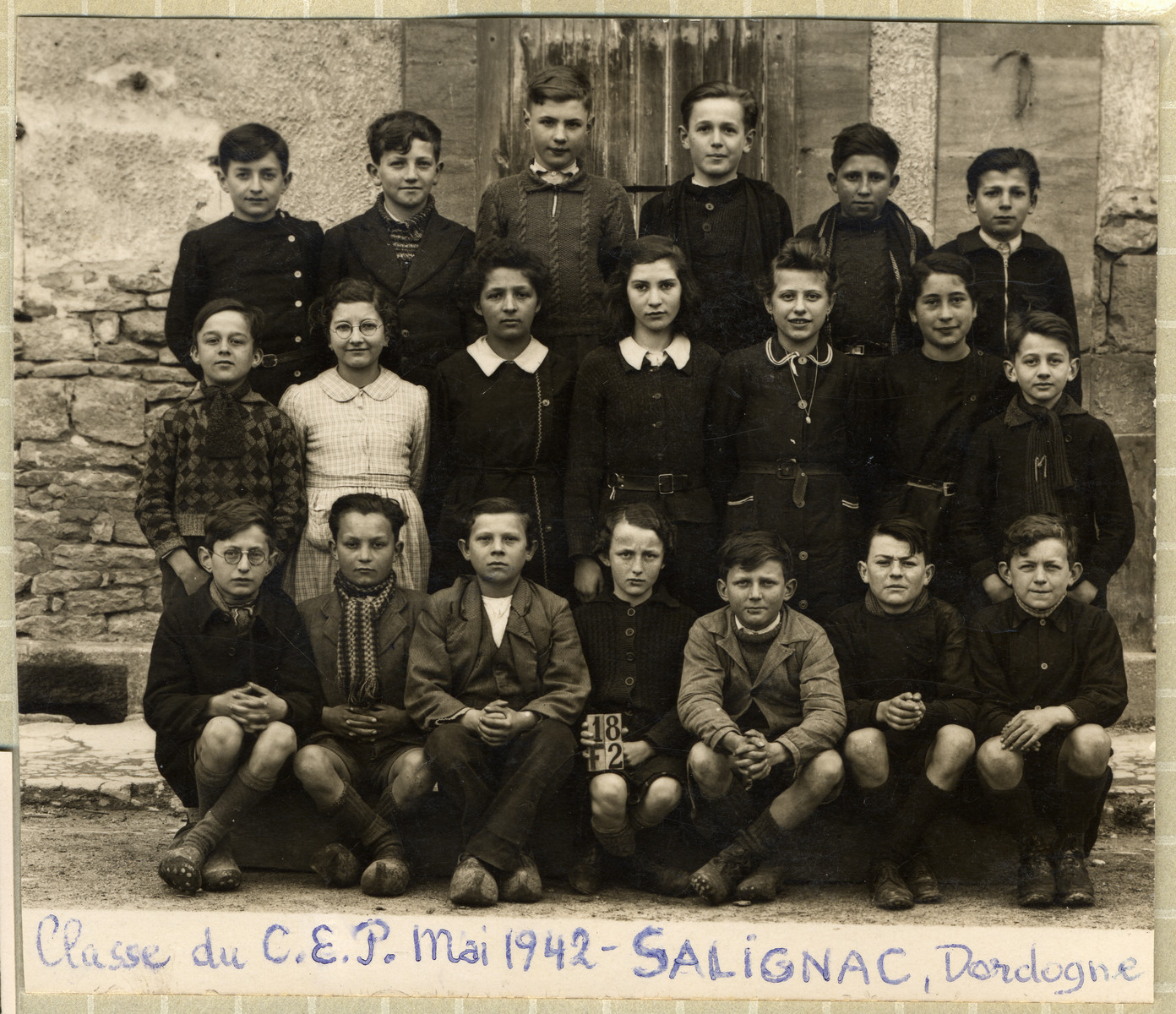 Group portrait of a school class in Salignac.  Among those pictured is Ingeborg Majewski who found shelter in the town together with her mother.