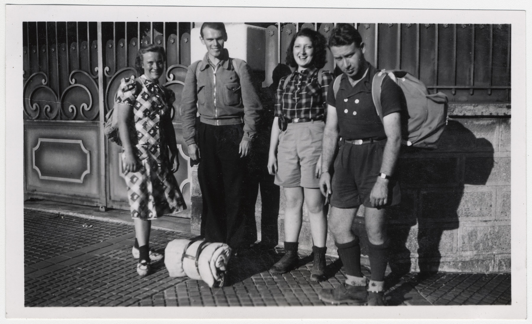 Four young people pose together with their backpacks and sleeping bags.    Henri Moskow is pictured on the far right.