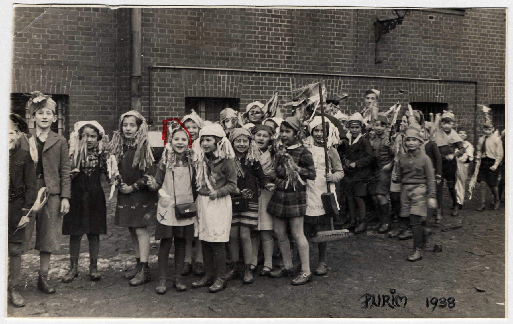 Children from the Jewish school in Koenigsberg line up in their Purim costumes.  Ingeborg Majewski is pictured fifth from the left.