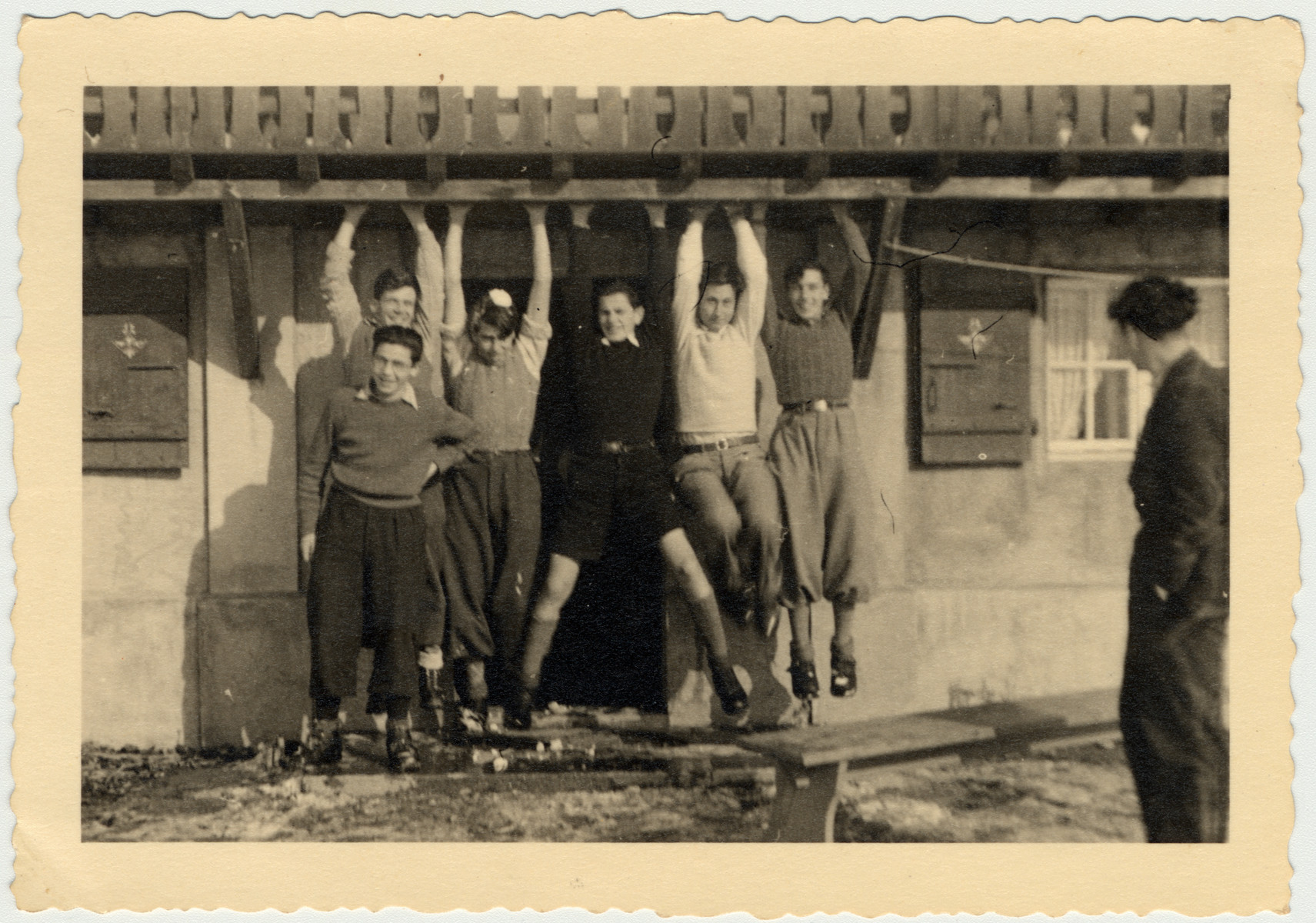 Members of Habonim from the Versoix and Les Murailles children's homes hang from the balcony of a chalet near Montreux where they had a winter camp.  Pictured from rom left to right  Theo Brenig, Ludwig Mayer, (both from Murailles)  Mouli , Max Wajsbrod (both Versoix), Kurt Heilbronner (today Uri Barnea) and Natan Alter (from Murailles).