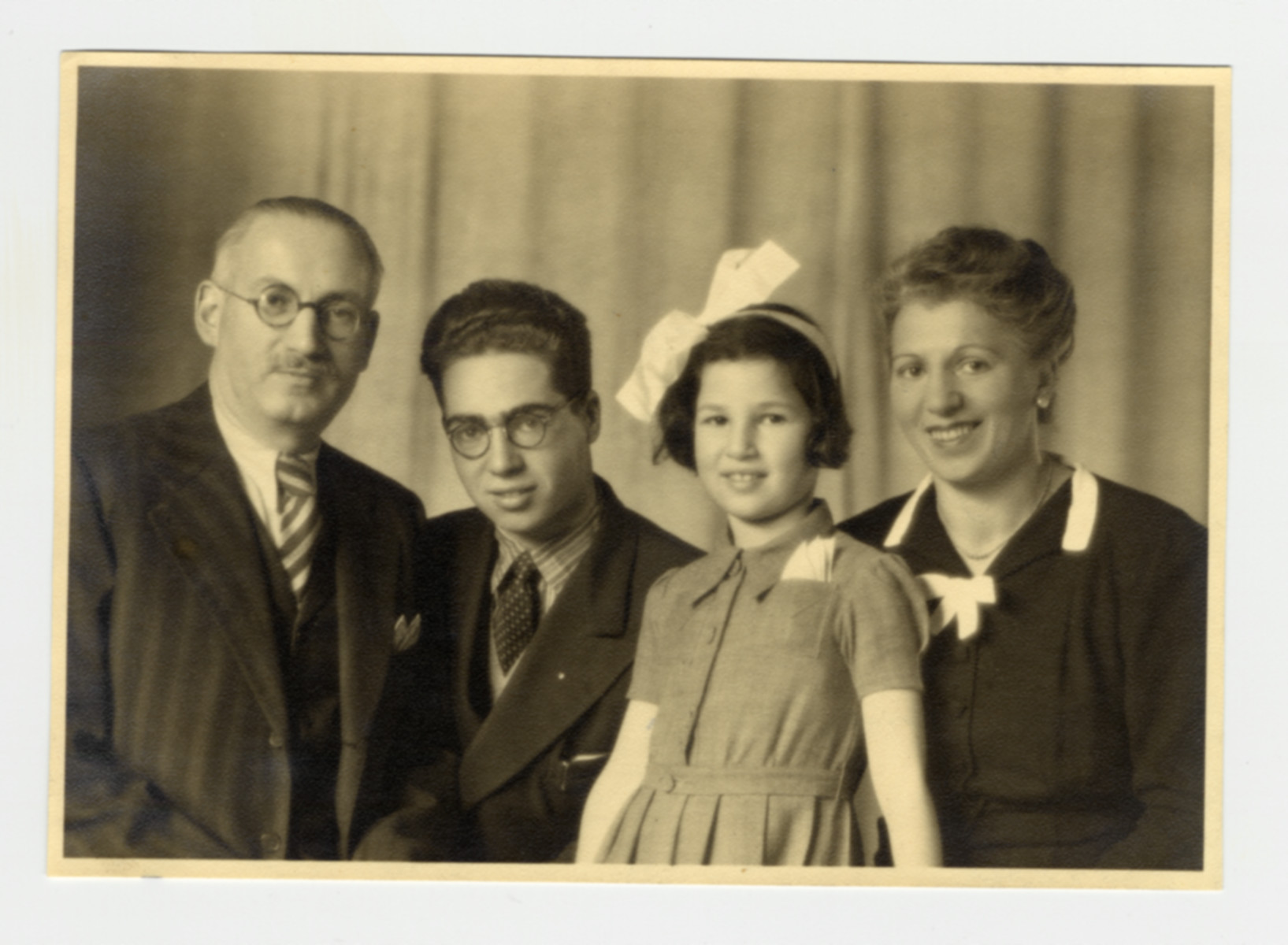 Studio portrait of a Jewish refugee family in Switzerland.  From left to right are Alfred, Kurt, Gertrude and Regina Frost.