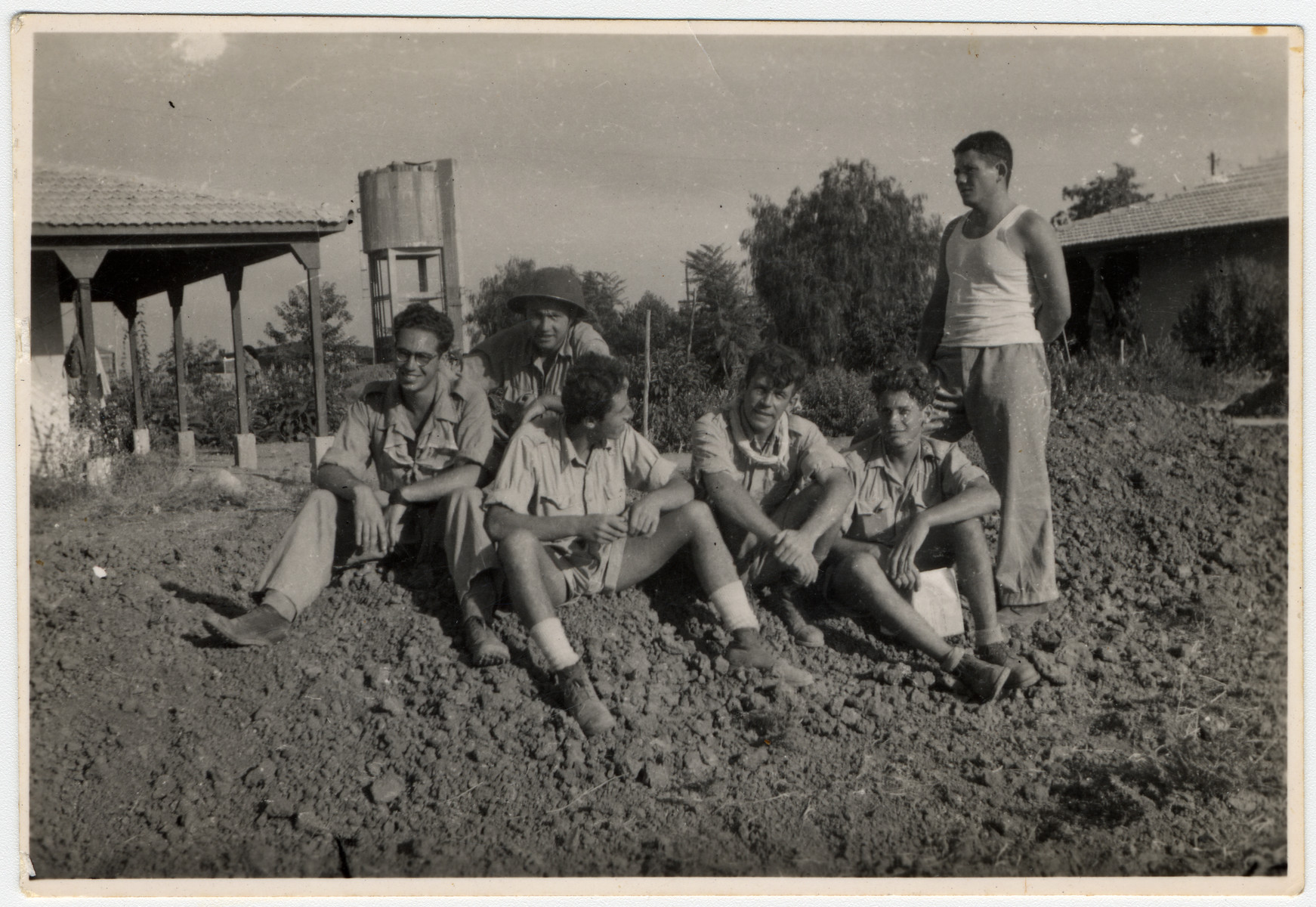 Members of a Palmach unit, most of whom had spent the war together in a children's home in Switzerland, rest on the grounds of an outpost.  Pictured from keft to right are Mordechay Frost, Tuvia Bergman, Ludwig Mayer, Werner Heilbronner (Daniel Barnea) and Danny Nir.  Danny Nir evacuated the donor, Mordechay Frost, after he was wounded.