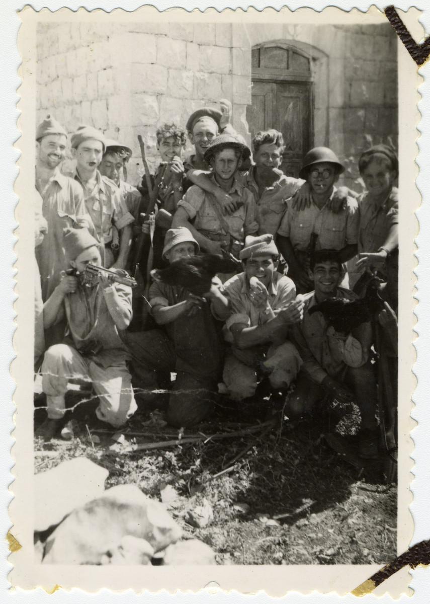 Group portrait of Israeli soldiers in El Kuban, outside of Latrun.