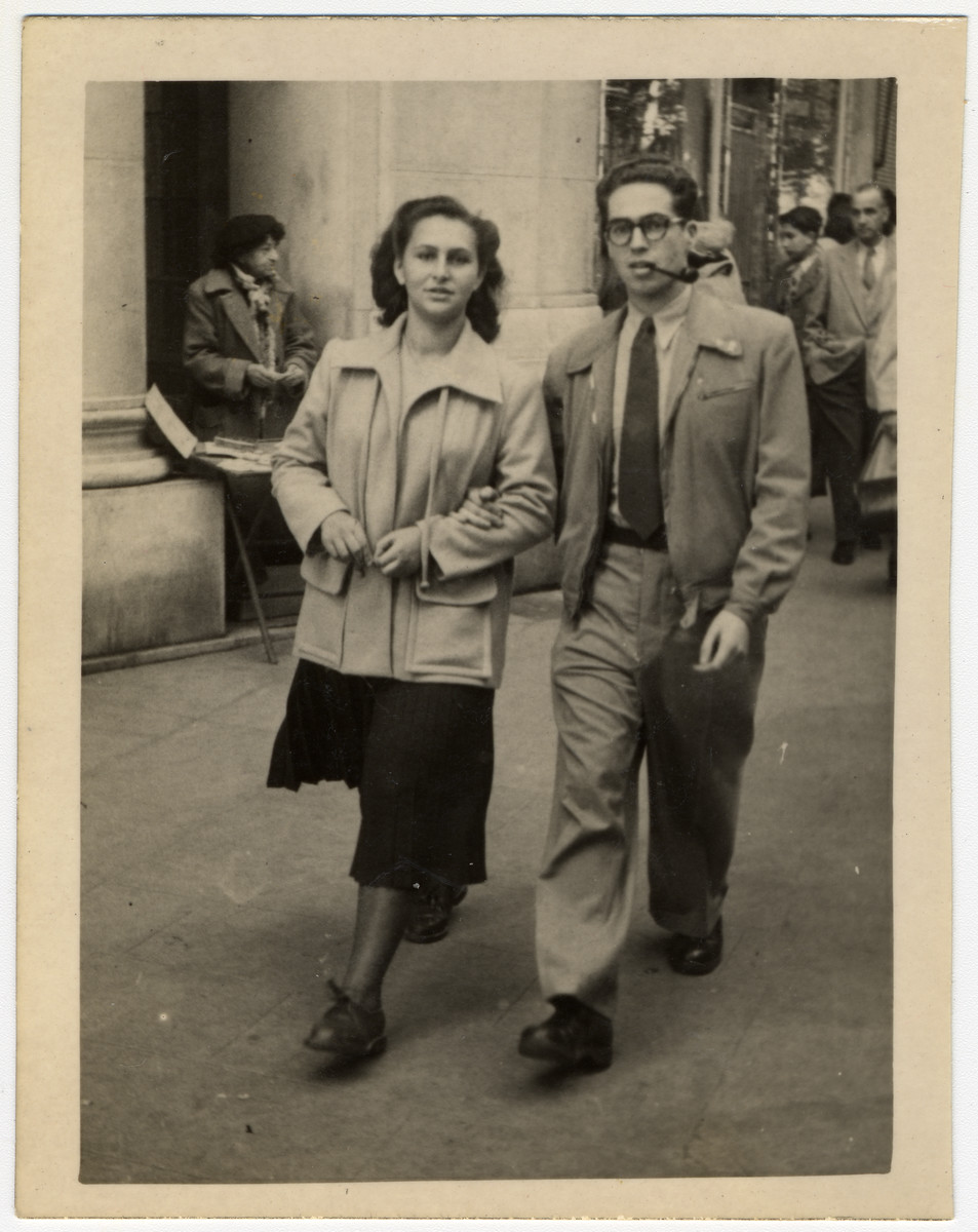 A recent immigrant to Palestine returns to Paris on a special mission for the government.  Pictured from left to right are Fanny Dainov and Mordechai Frost.