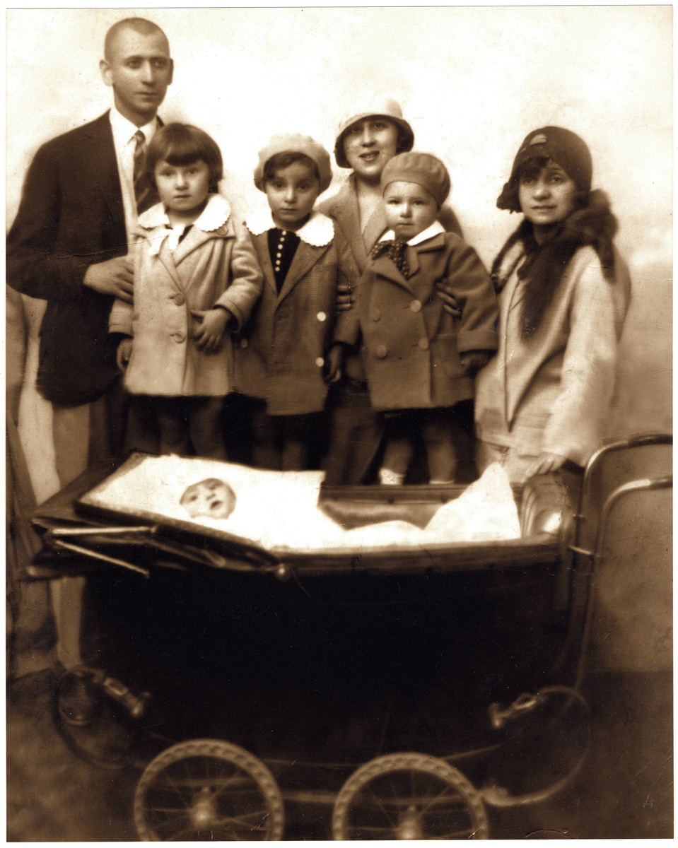 Portrait of an extended Romanian Jewish family.    From left to right are Marcell Jozsef, Gabriella Fritsch, Andrew Fritsch, Irene Jozsef, Andrei Jozsef and Fanny Fritsch.  The donor, Gheorghe Jozsef, is in the baby carriage.  Fanny later perished in Auschwitz.