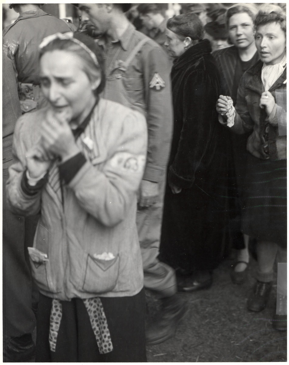 German women are forced to view the atrocities committed at the Woebbelin concentration camp.