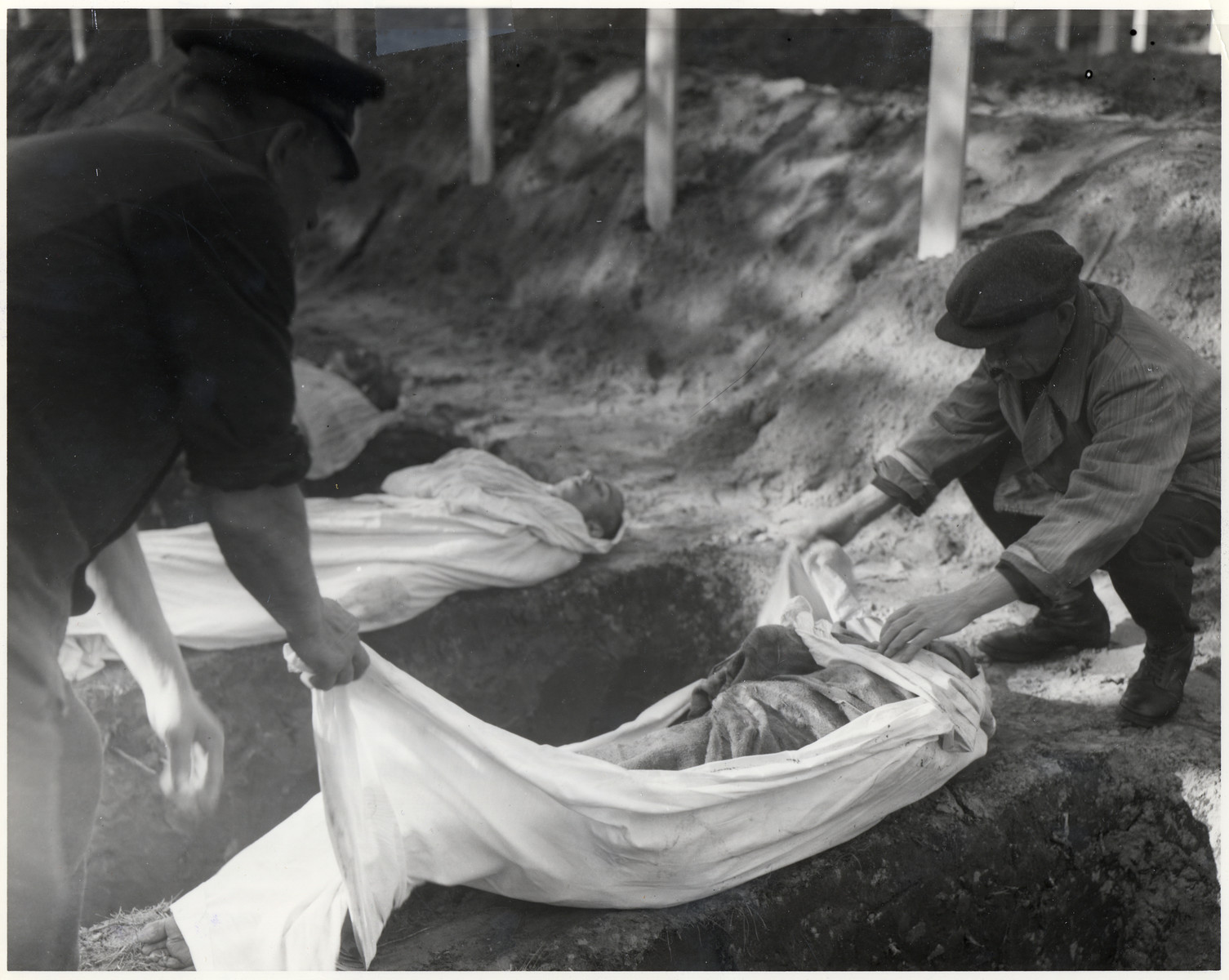 American soldiers force German civilians to participate in the burial of prisoners who died in the Woebbelin concentration camp.