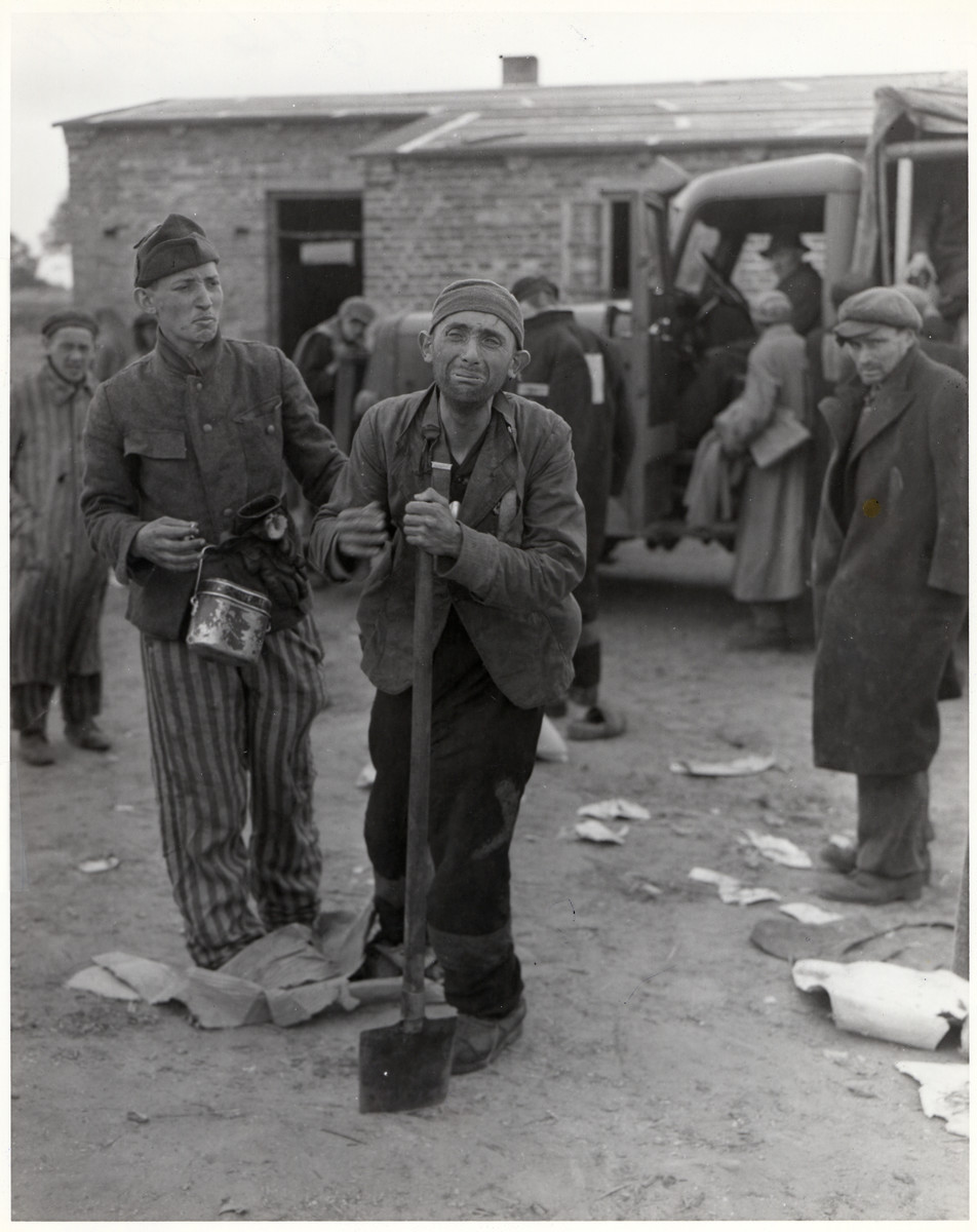 "Starving prisoners are liberated in the Woebbelin concentration camp.  Original Caption: ""At the German concentration camp in Wobbelin, many inmates were dying of starvation when troops of the U.S. Ninth Army captured the camp. Here an inmate thinks he has been forgotten when some have been removed to hospitals, but he will leave as soon as the worst cases have gone. 82nd Airborne Div., Wobblin, Germany. 5/4/45."""