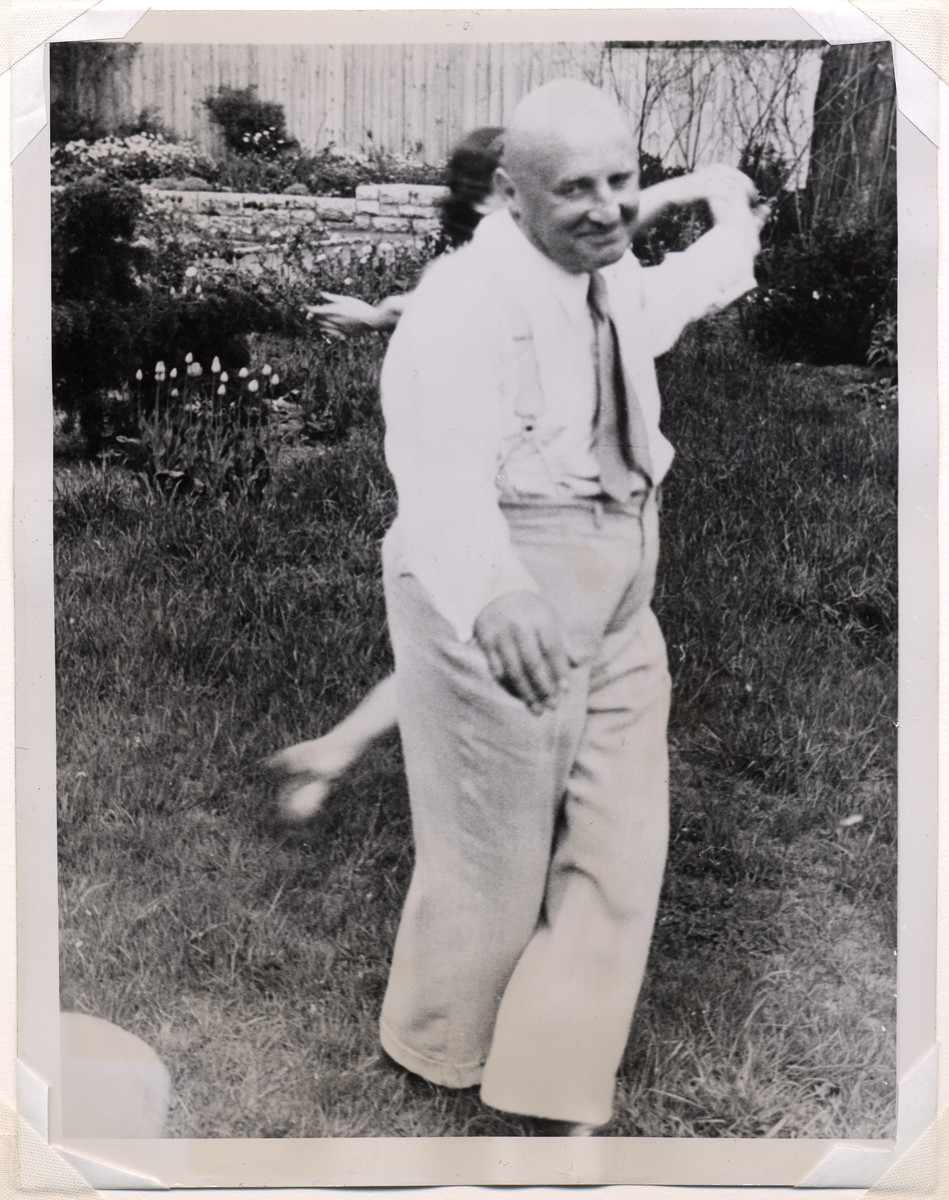 Julius Streicher dances outside with an unidentified woman.
