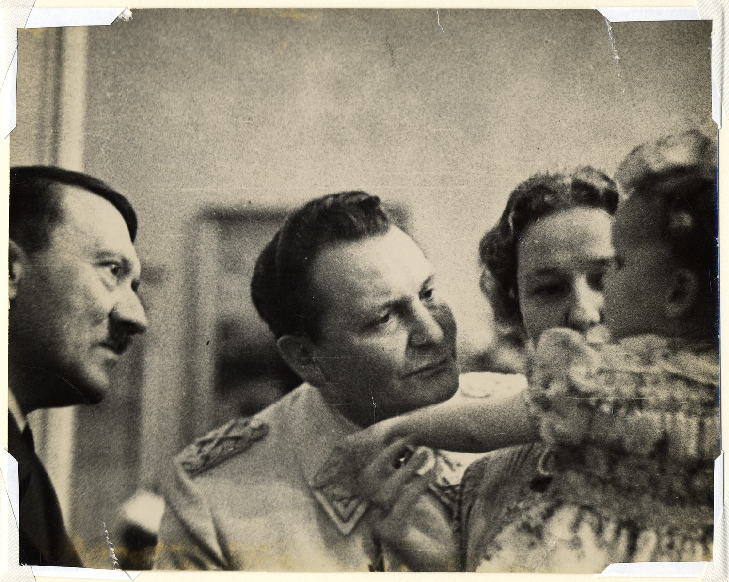 Hermann Goering, his wife, Emmy and child, Edda meet with Adolf Hitler.