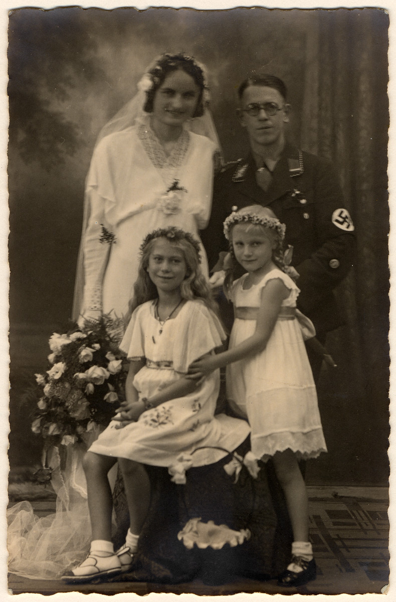 Wedding portrait of an SS officer with his wife and two children.
