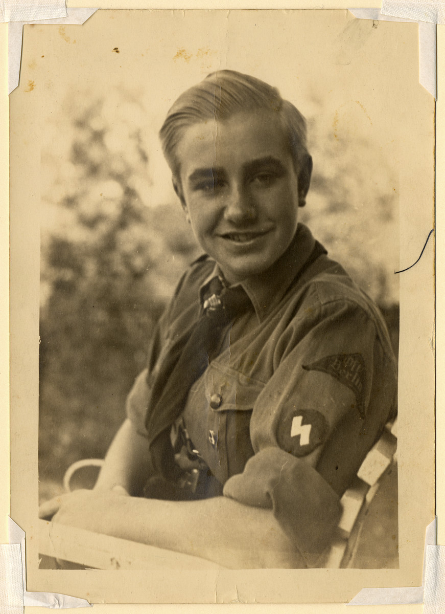 A member of the Hitler youth poses for a photograph.