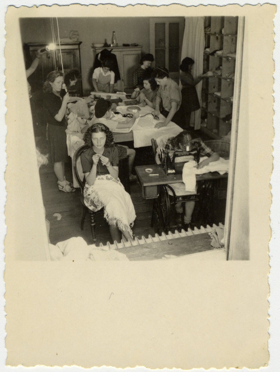 Girls learn to sew in the Versoix children's home.  Pictured in front is Fella Horowitz (Tamar Ben-Porat).