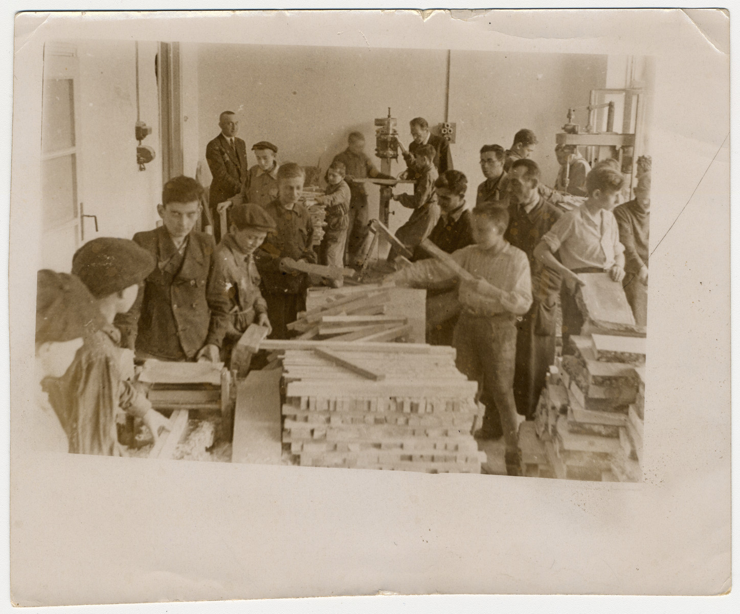 Children working in a wood workshop in the Lodz ghetto.