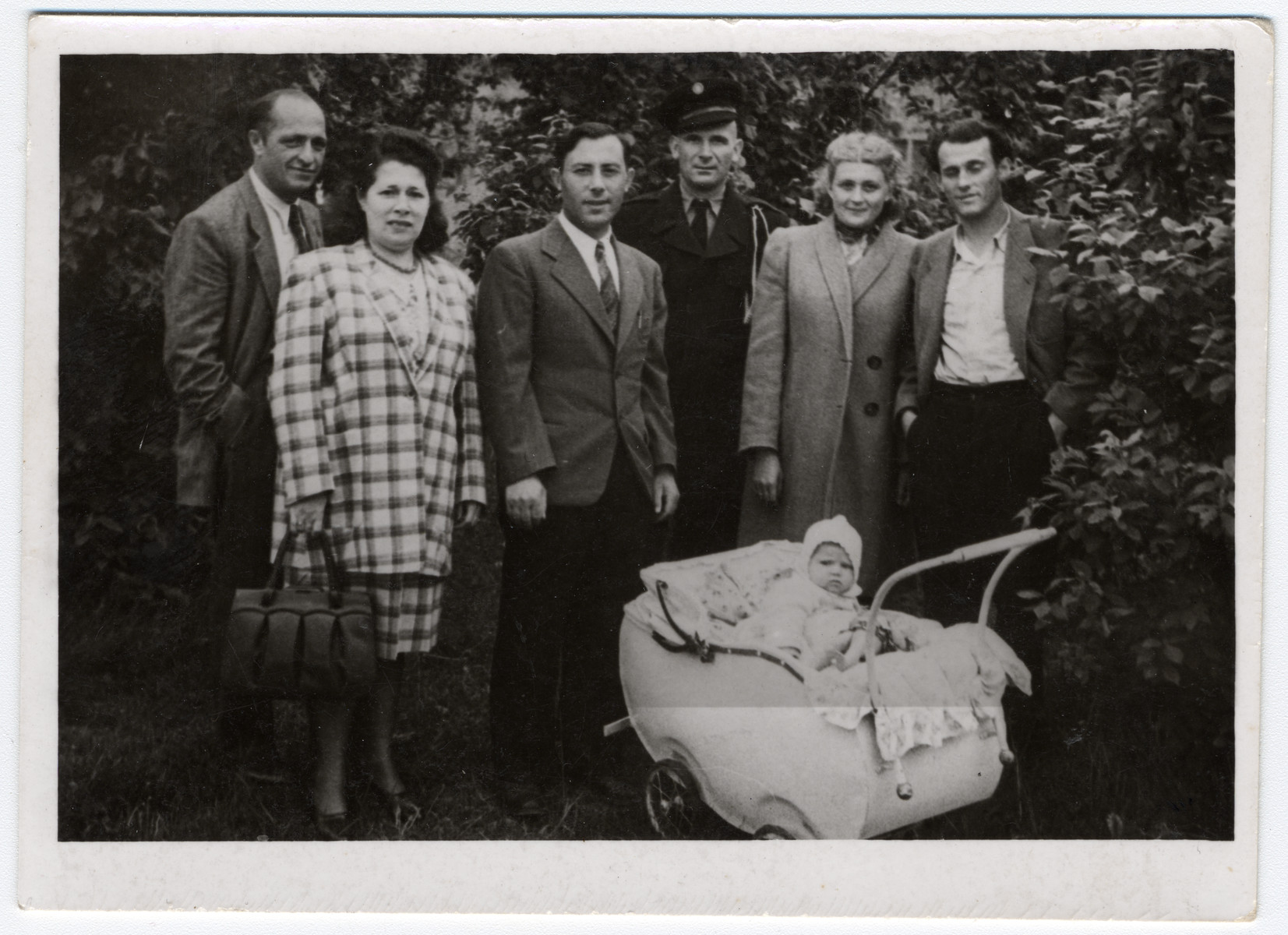 Group portrait of Jewish displaced persons in Leipheim.  From left to right are an unidentified couple, Rubin Kaplan, Zalman Kaplan (his cousin), Dwora (another cousin) and her husband Eli Flaks and their infant Pearl.