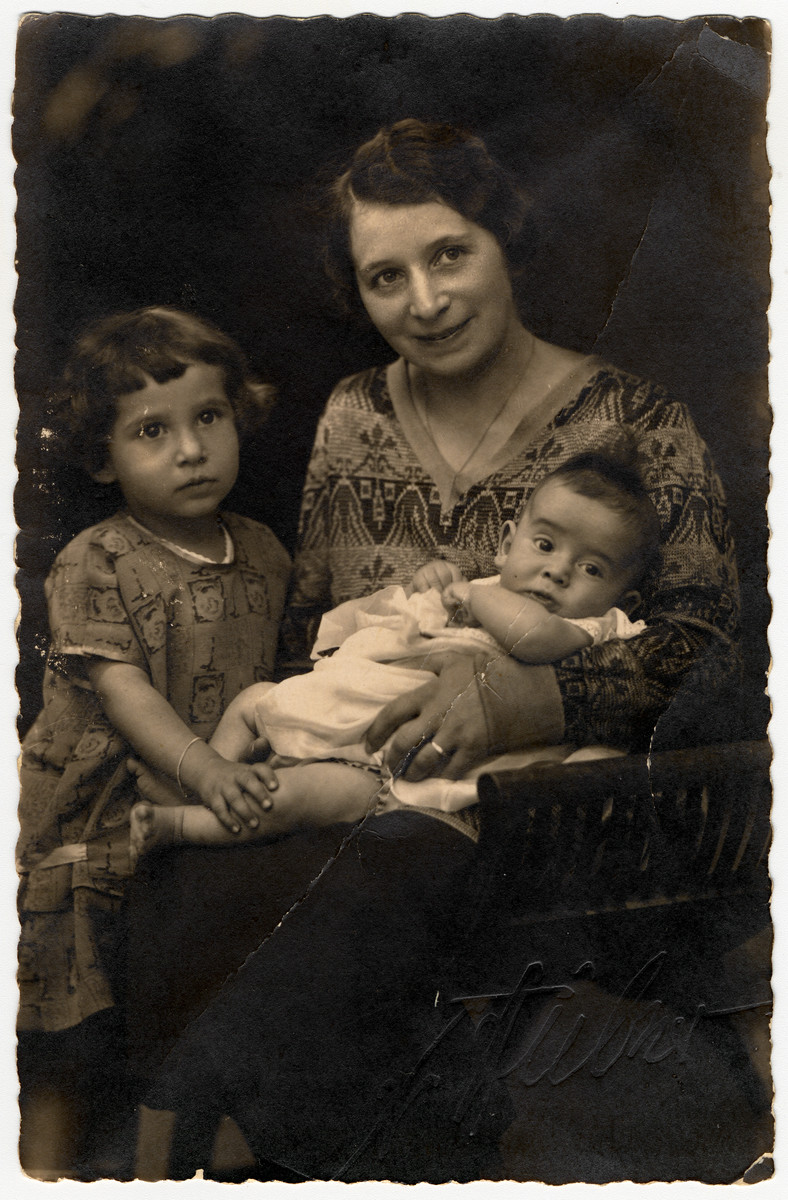 Studio portrait of the Ottenheimer family.  Pictured are Klara Ottenheimer (Nov 4, 1892), her daughter Ilse (April 26, 1922), and son Fritz (Mar 18, 1925).  Father is not shown born Dec. 3, 1886.