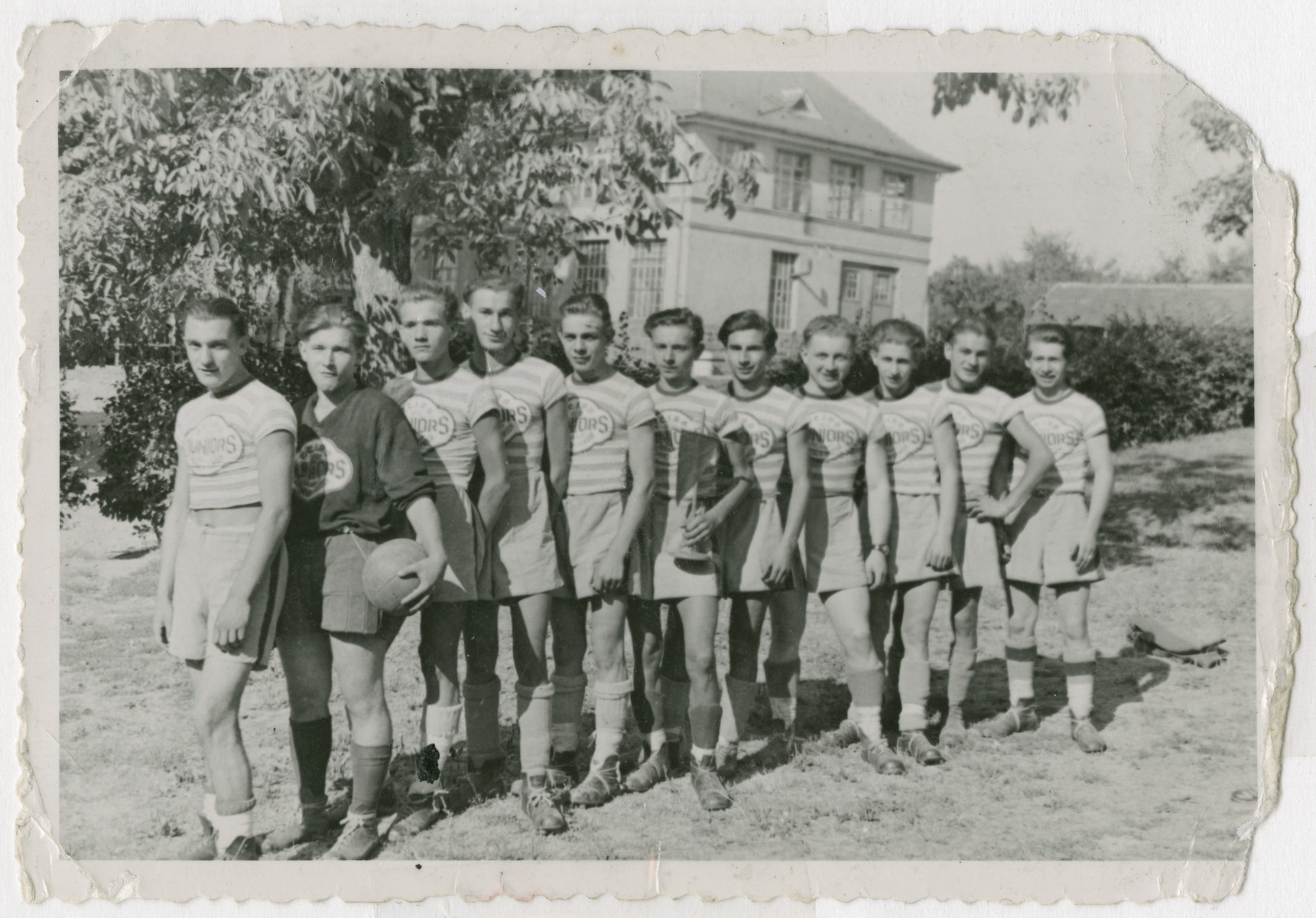 Group portrait of the soccer team of the Aglasterhausen postwar children's home.  Sziku Smilovic is pictured fifth from the right.