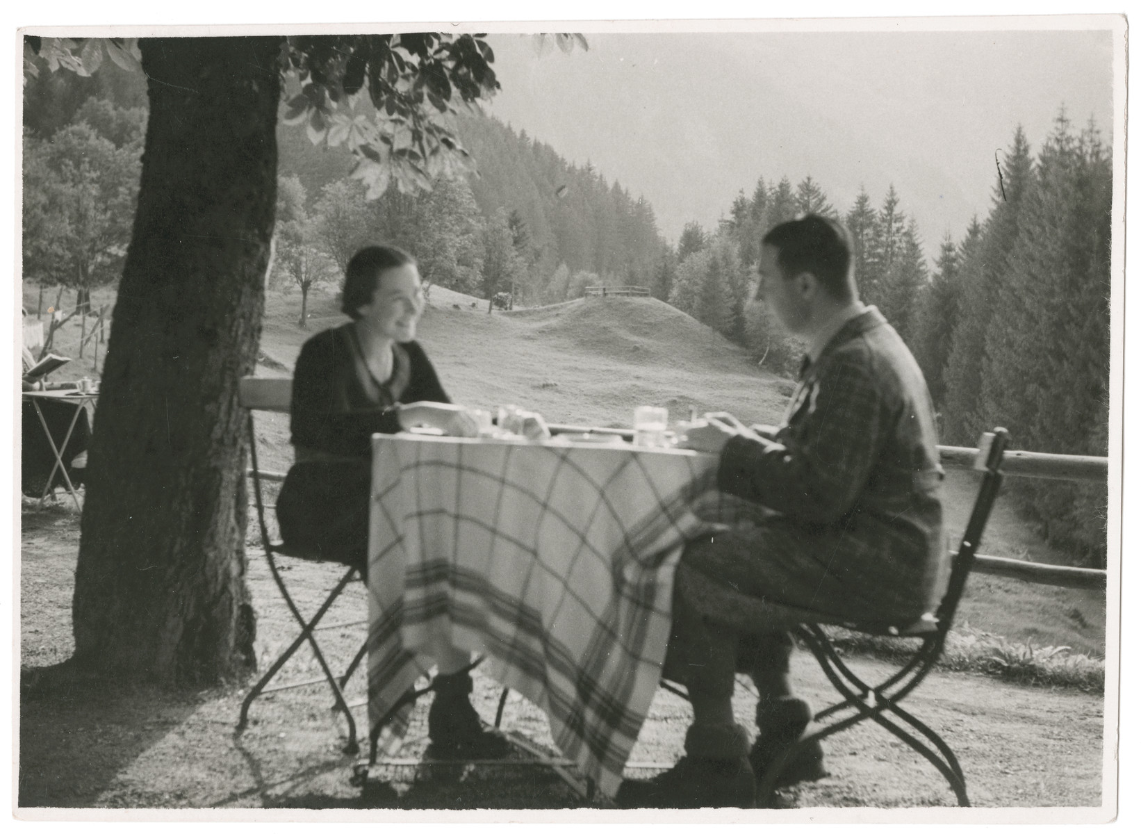 Vilma and Kurt Grunwald enjoy a meal in the countryside.