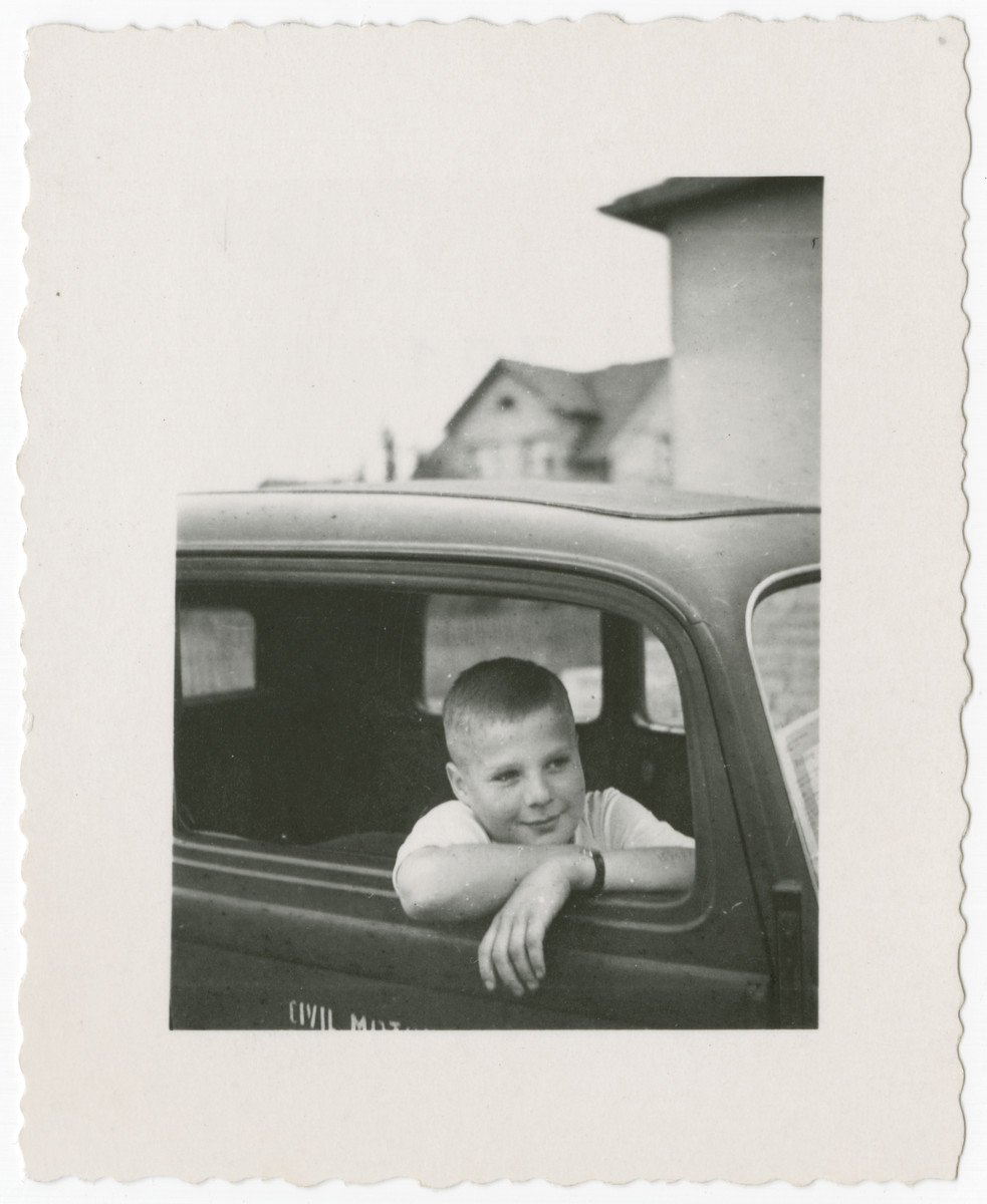 Misa Grunwald sits inside an automobile a couple of months after his liberation from Mauthausen and shortly after his return to Czechoslovakia.
