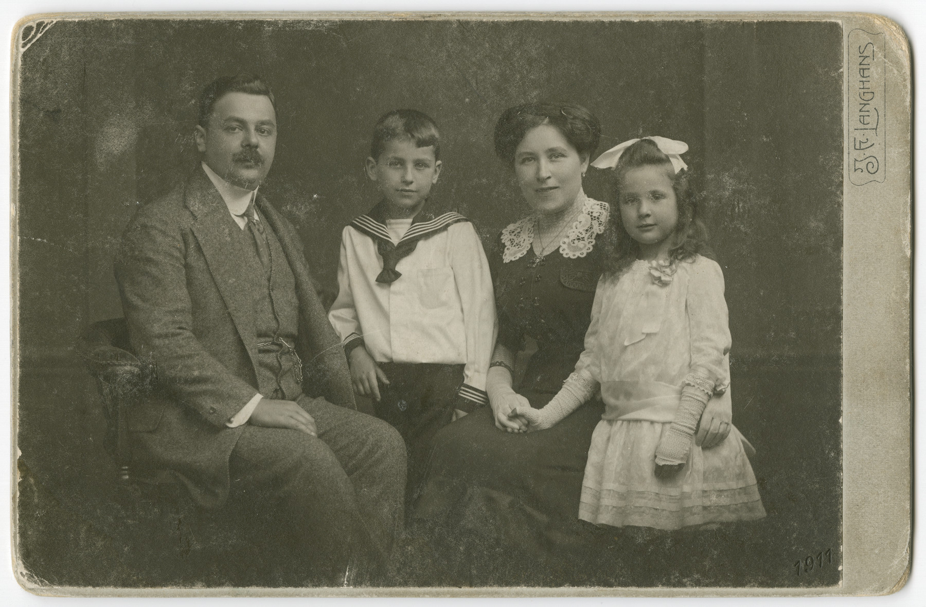 Studio portrait of the Eisenstein family.  From left to right are Otto, George, Matilda and Vilma Eisenstein.  All four perished in the Holocaust.