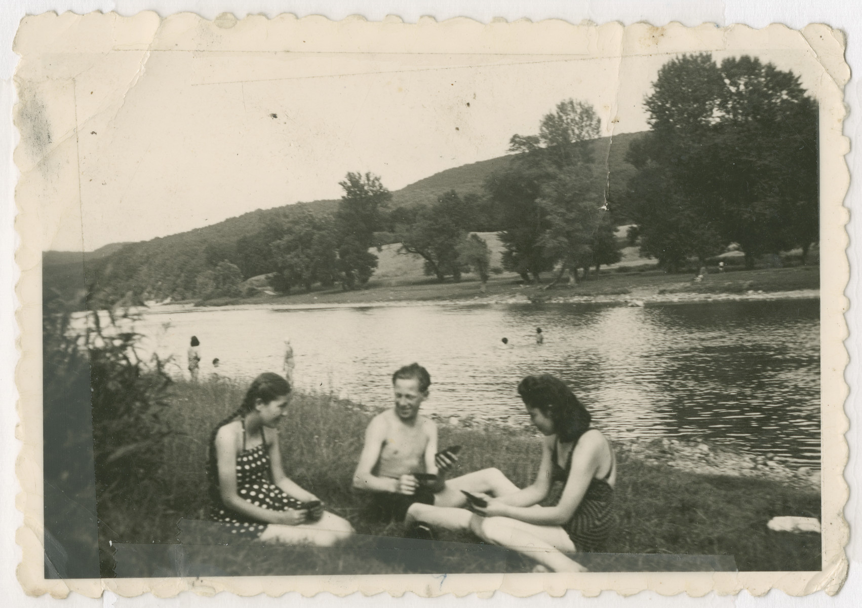Three Jewish survivors relax by a river bed after the war.  From left to right are Jolly, unknown and Aranka.  The two women are cousins of the donor.